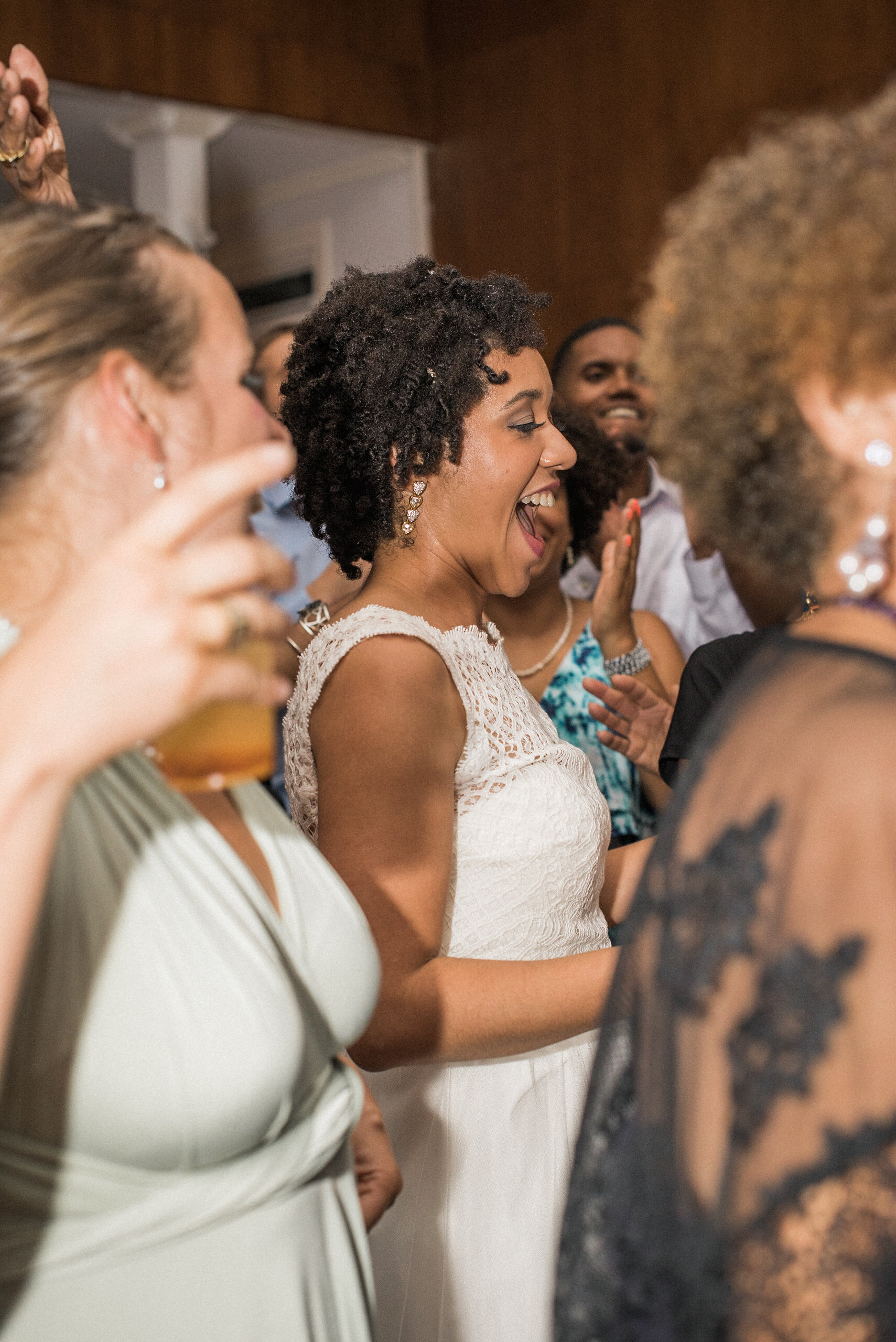Bride in crowd of people at reception
