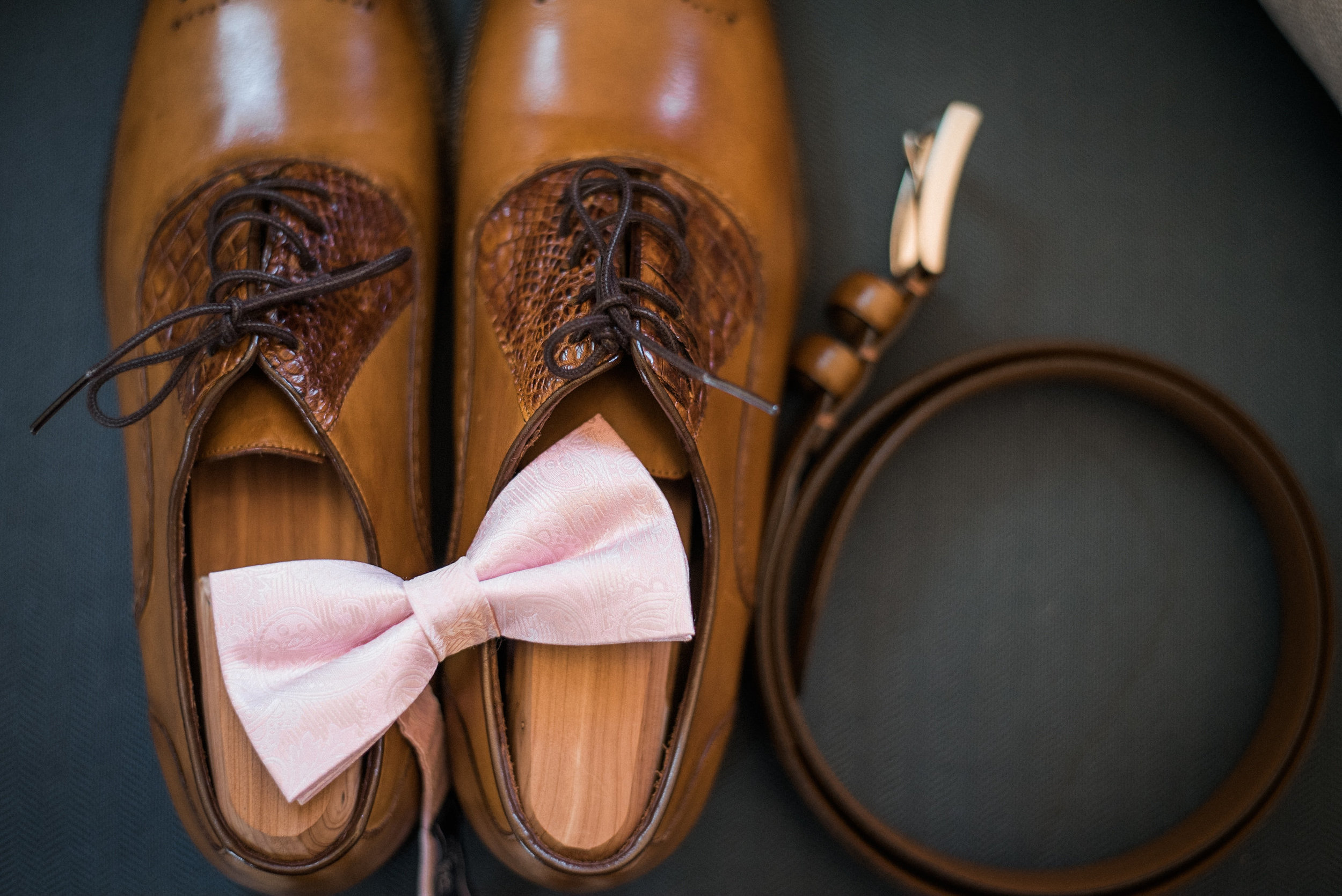 Groom's shoes and belt buckle