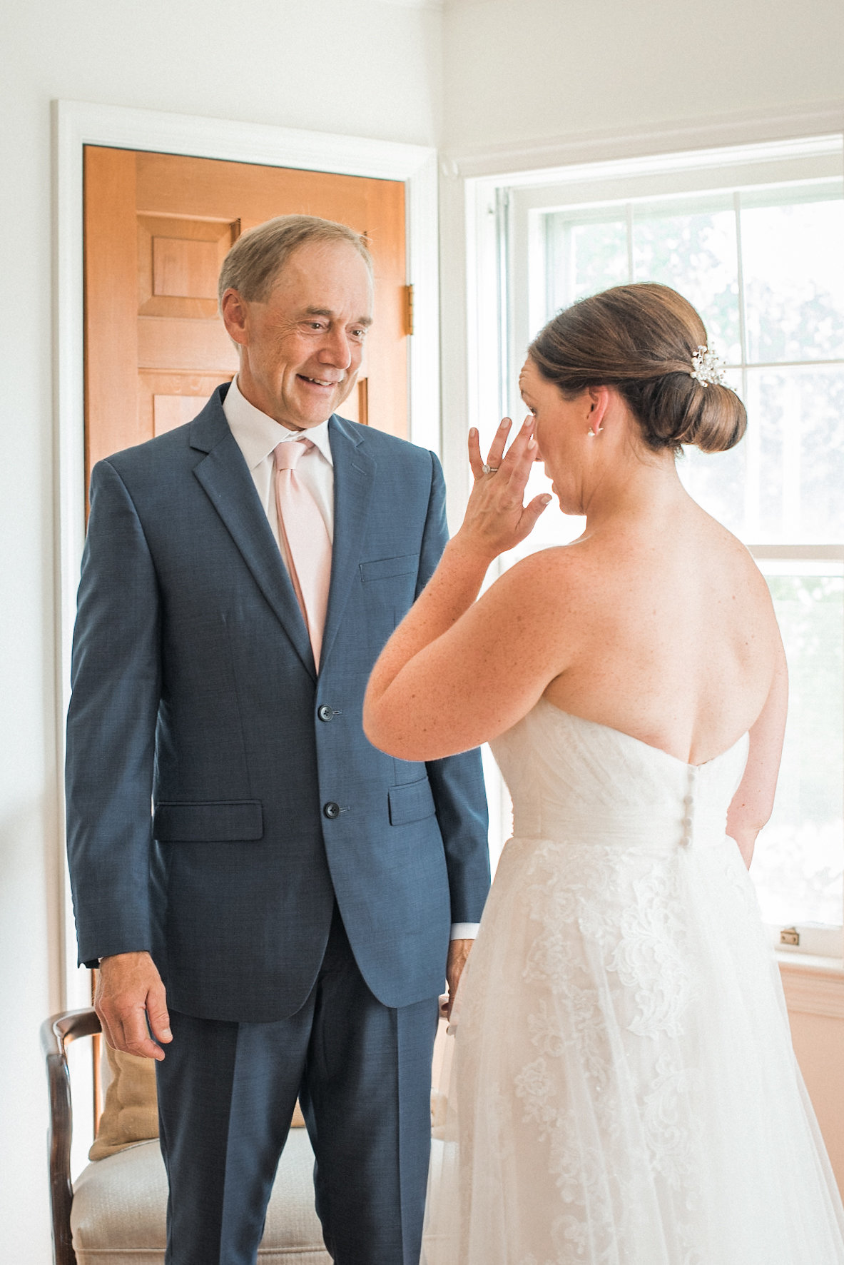 Bride crying with father