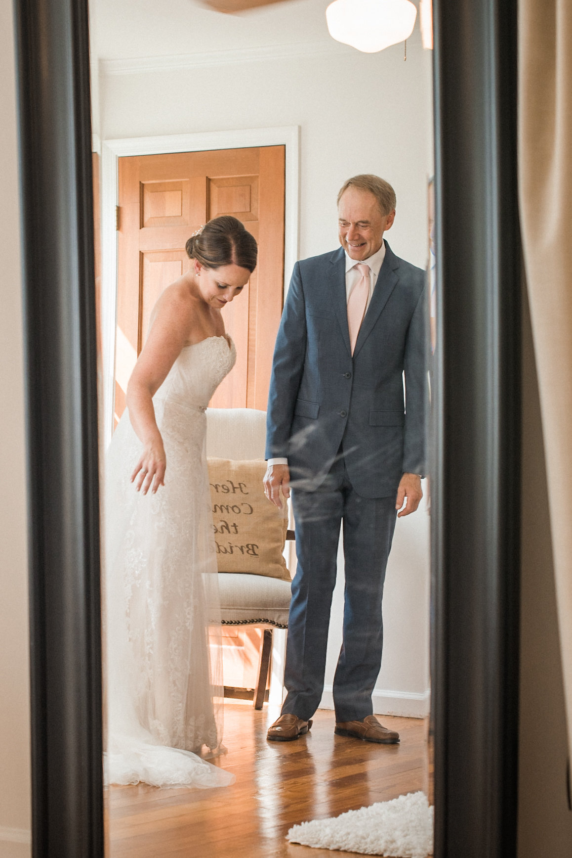 Bride and father in mirror