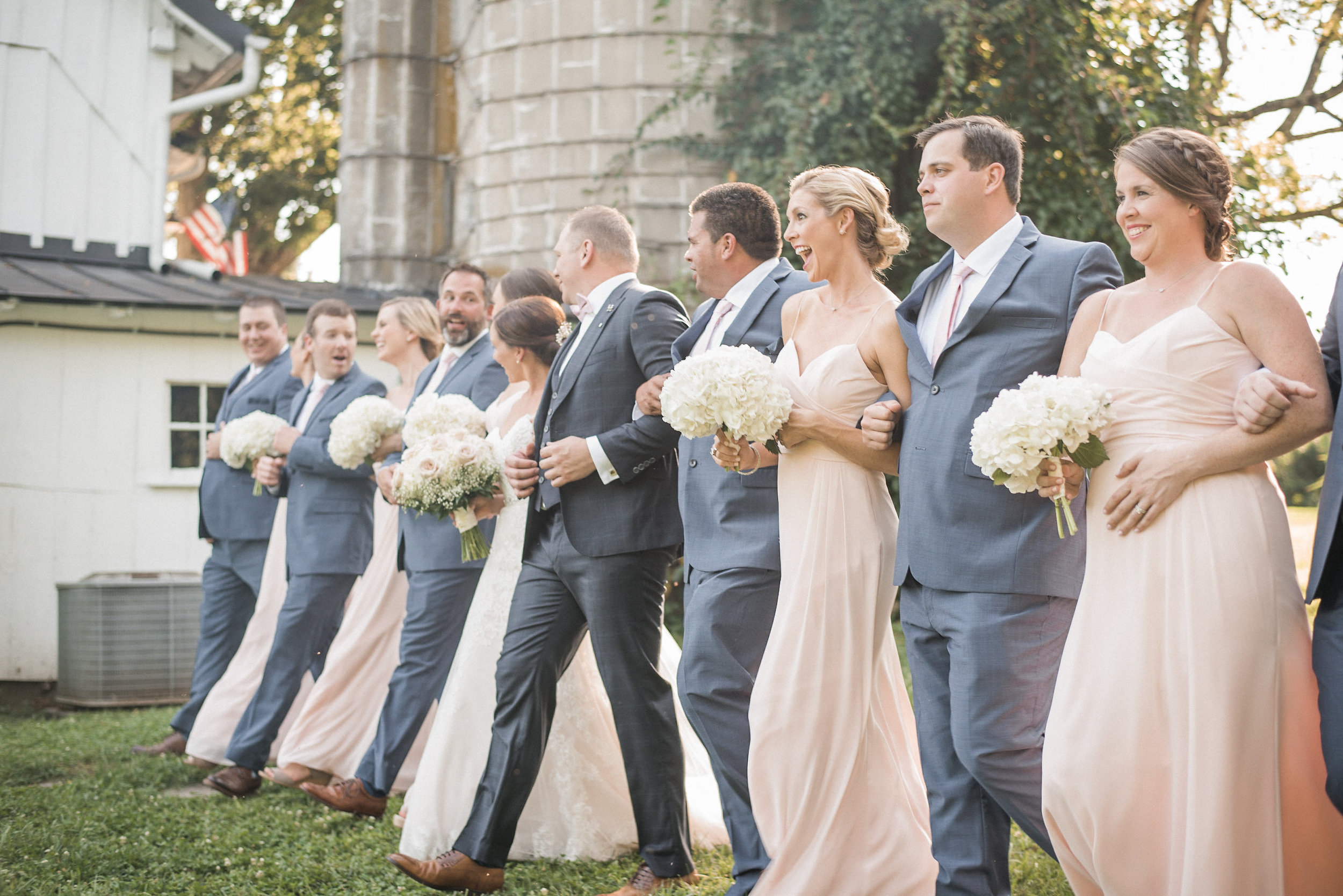 Bridal party walking on lawn