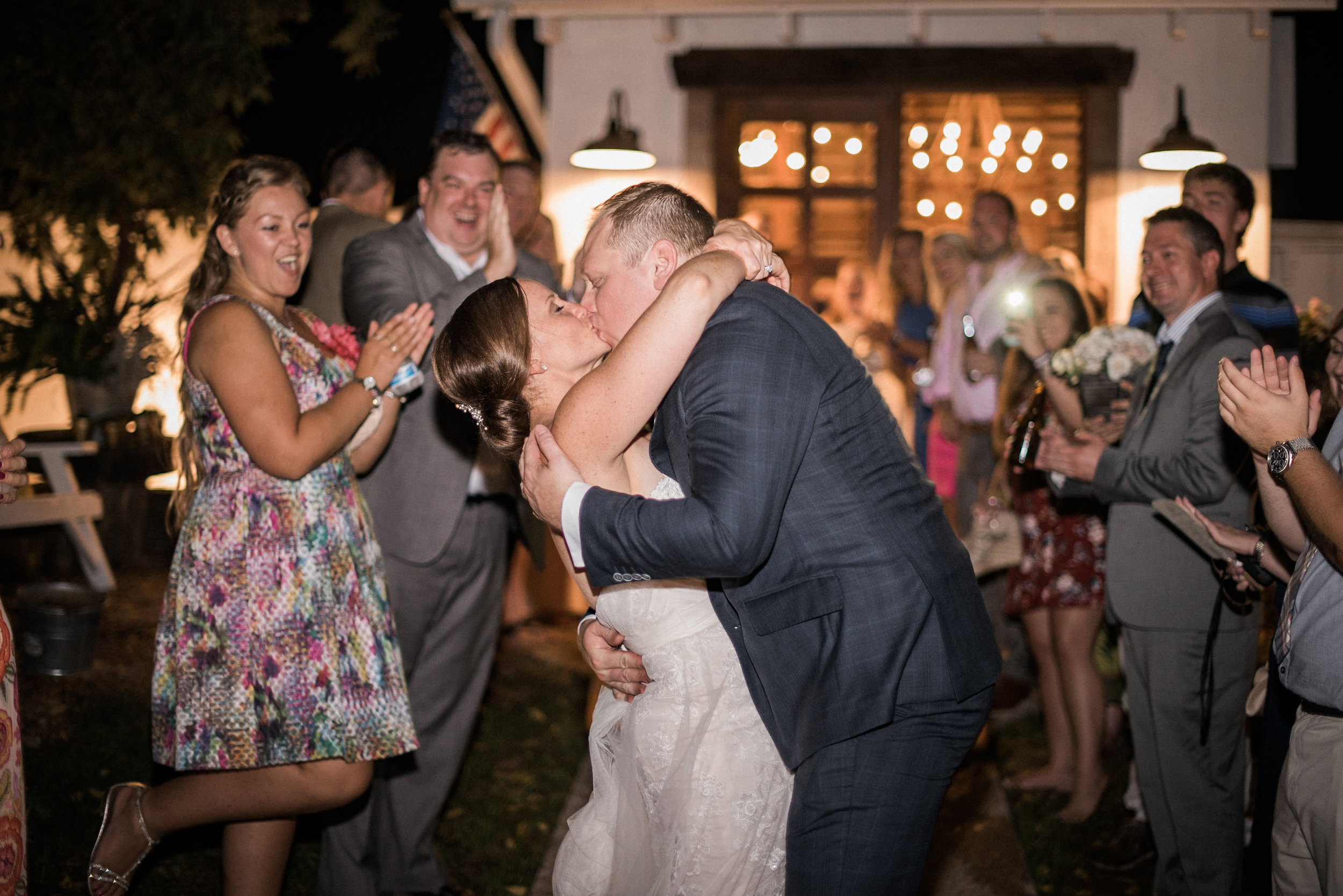 Bride and groom kissing at end of night
