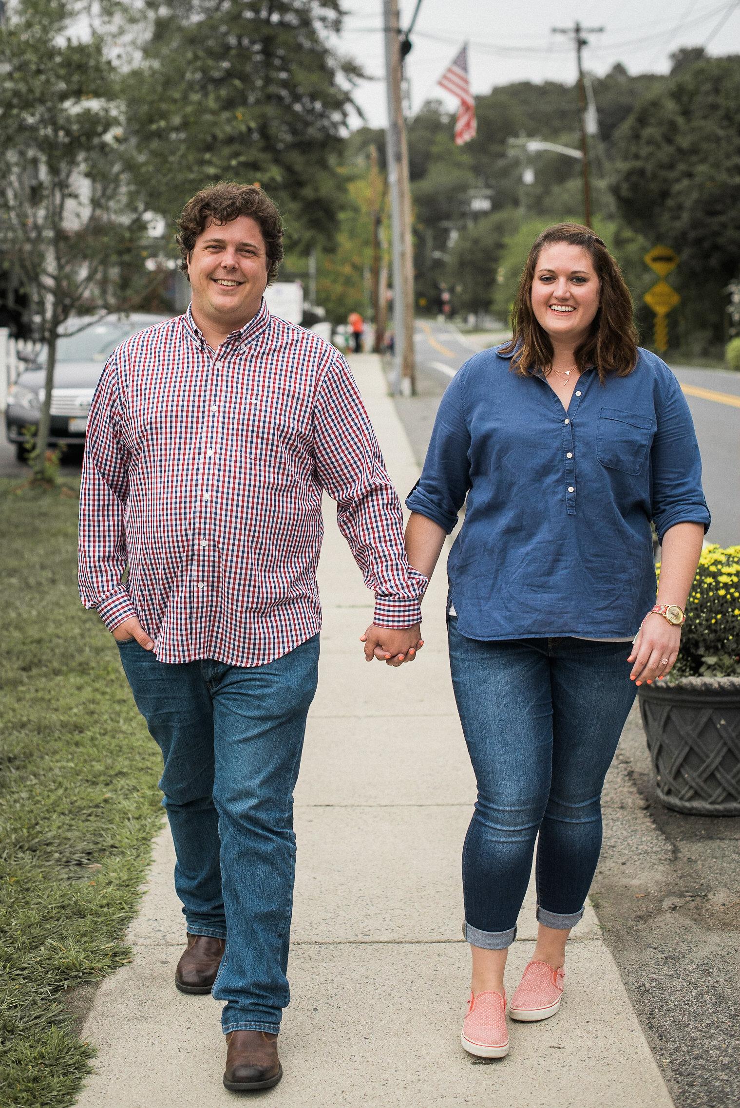 Couple walking down sidewalk