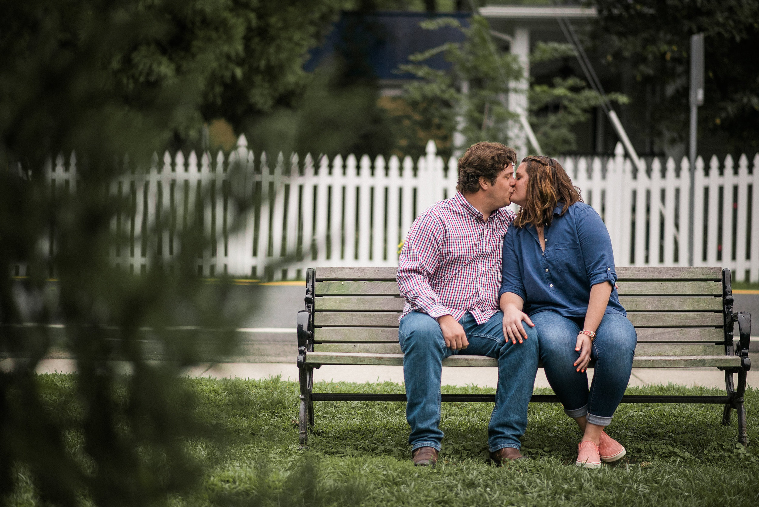 Couple kissing on bench