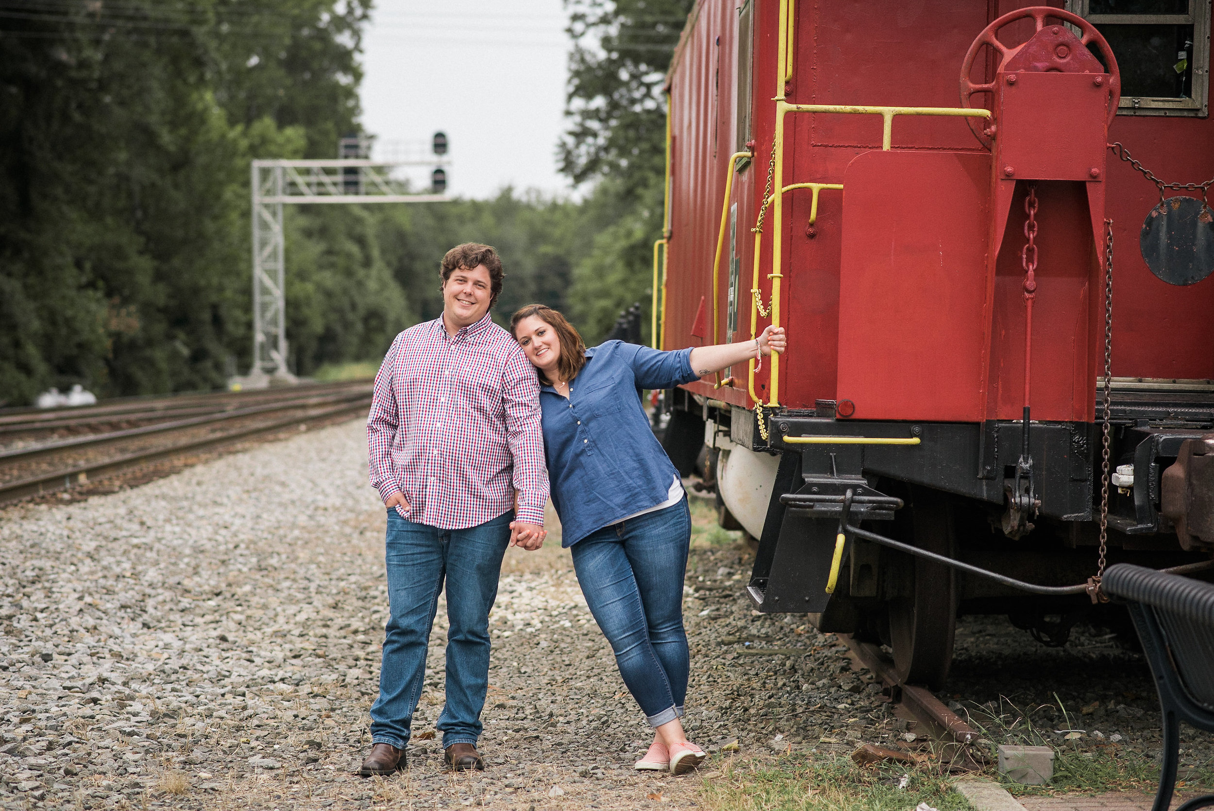 Man and woman next to rail car