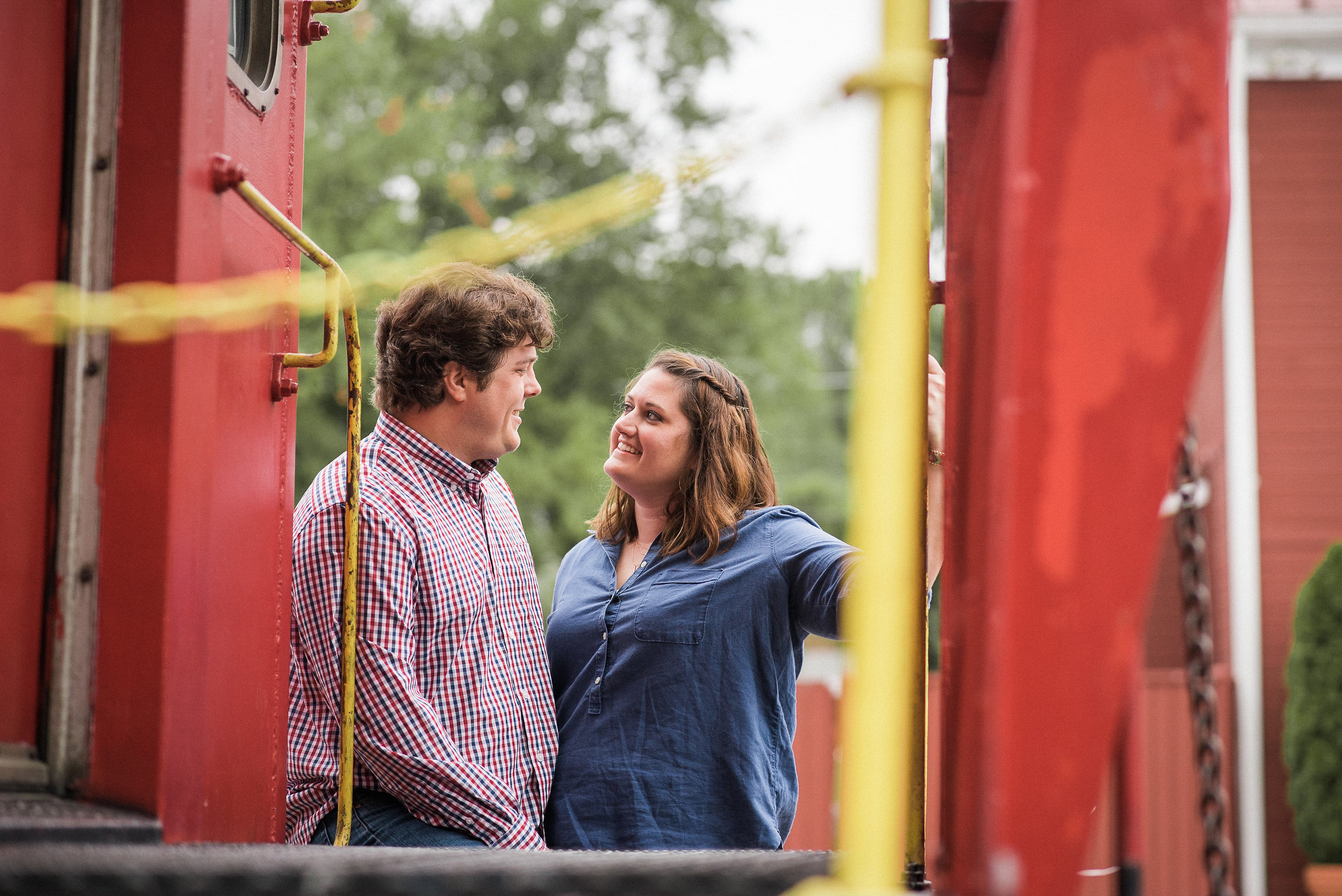 Man and woman next to caboose
