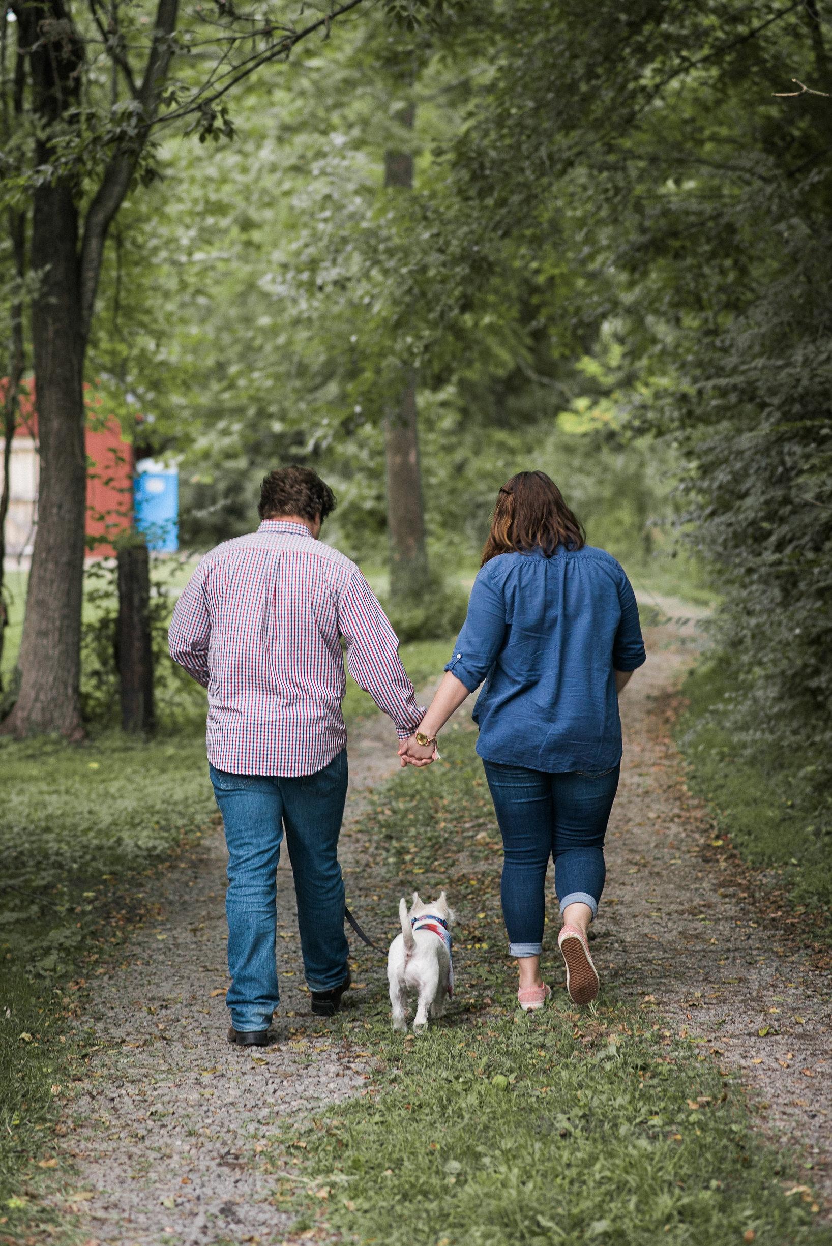Couple walking away with dog