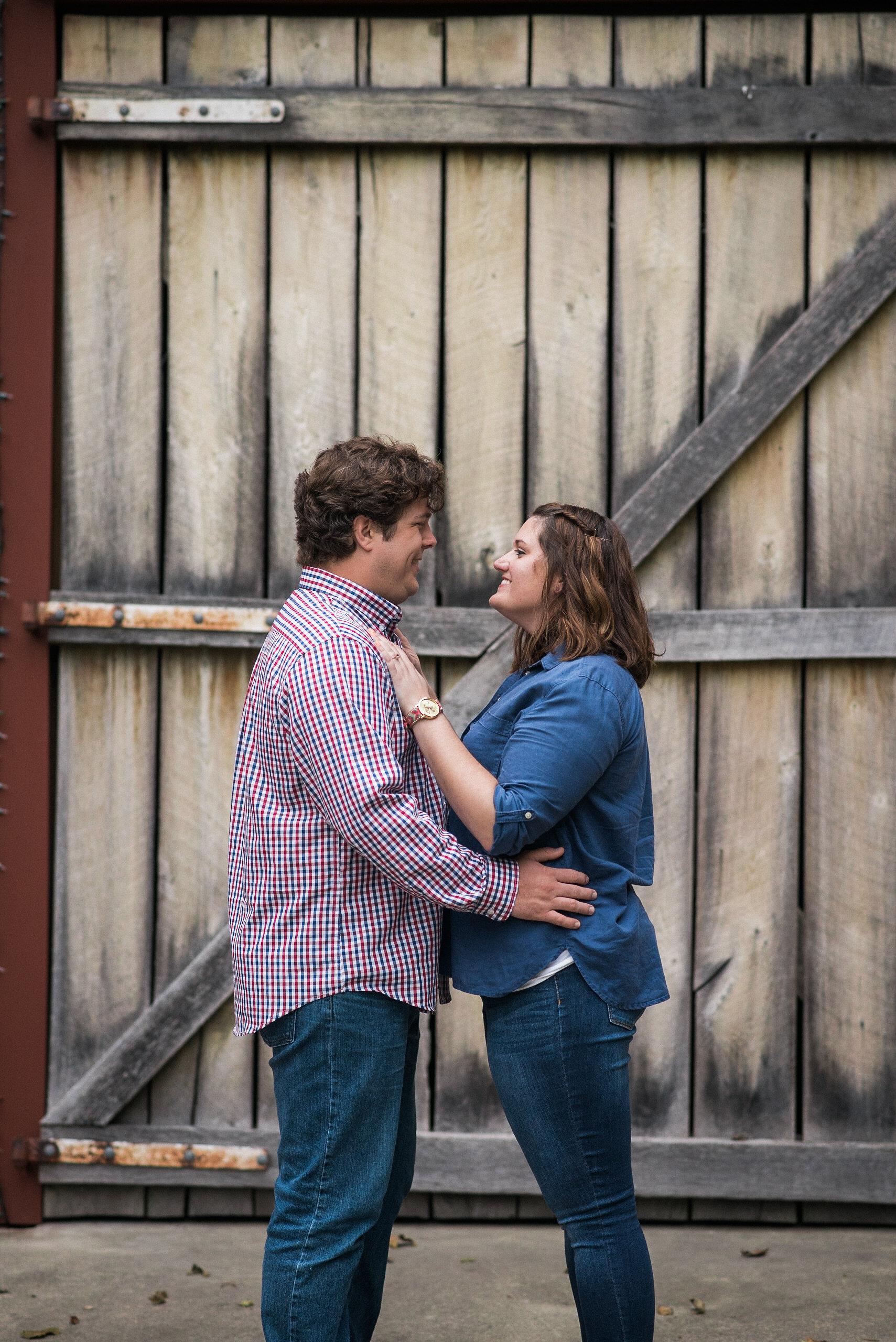Couple hugging in front of wooden door