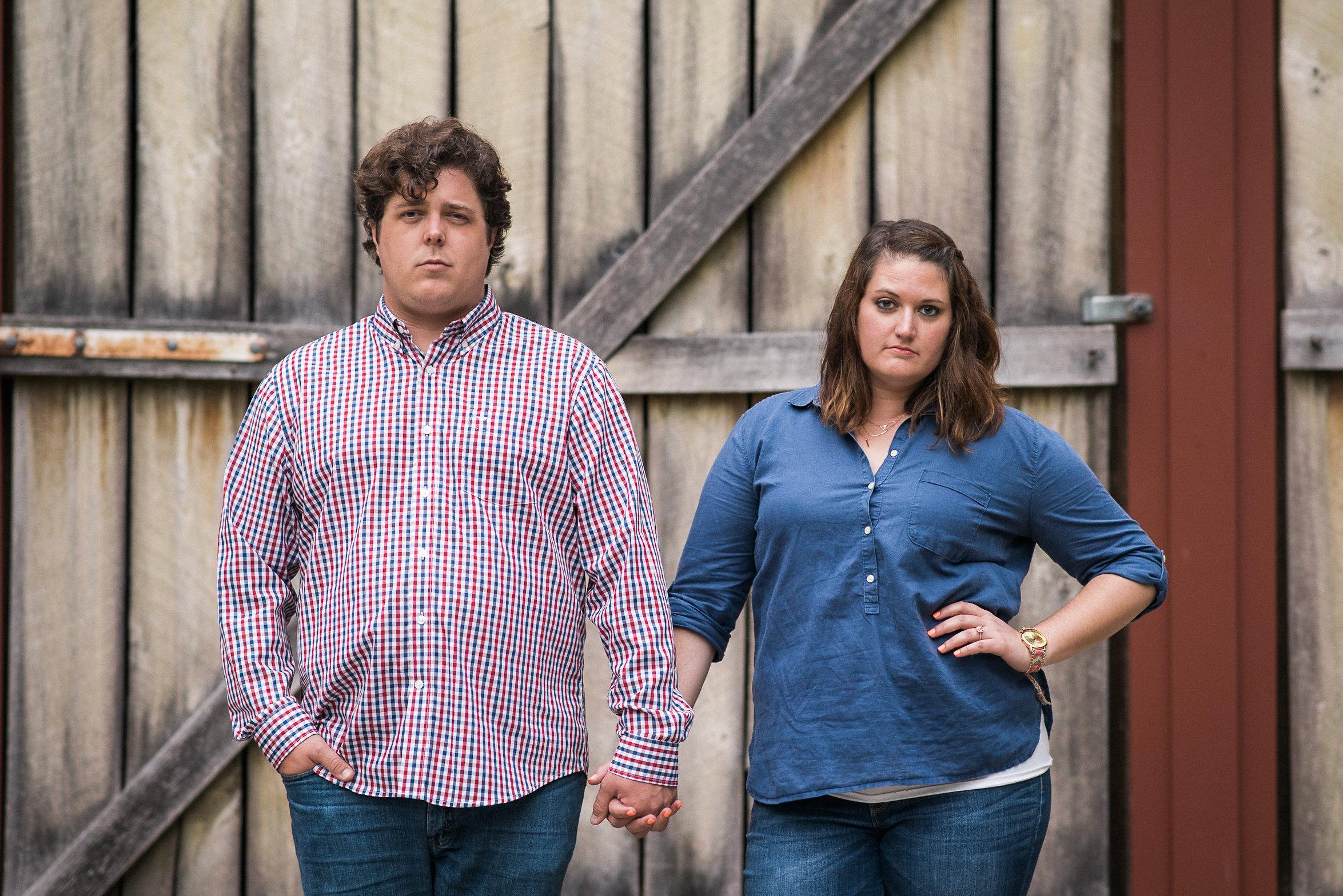 Couple posing in front of wooden door