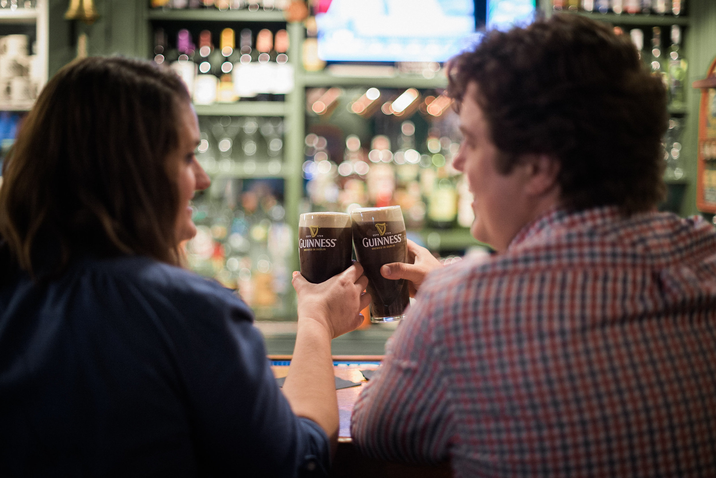Man and woman sharing a drink