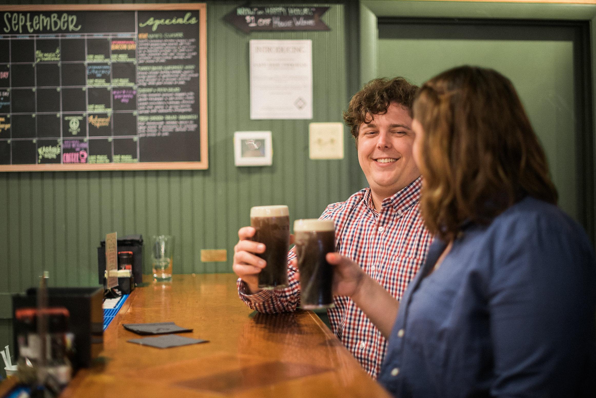 Man smiling at woman in soda shop