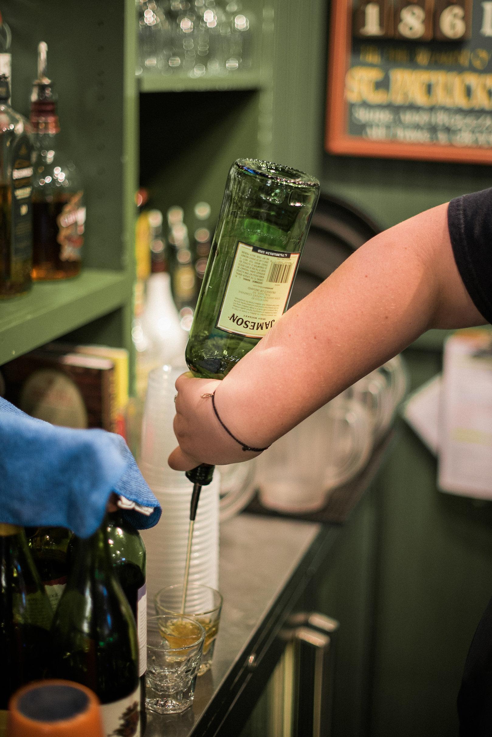 Bartender pouring shot of whiskey