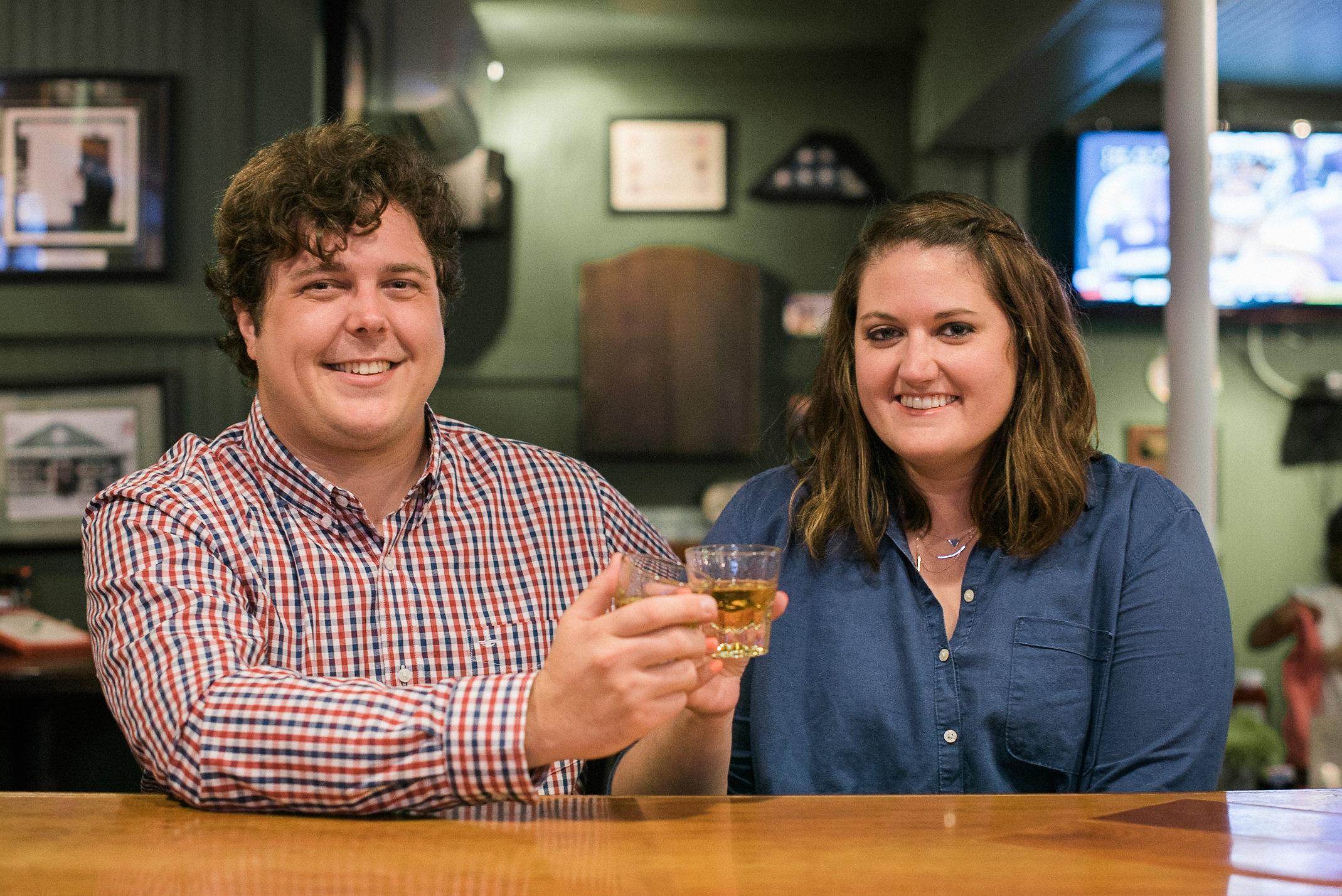 Couple sharing shot of whiskey