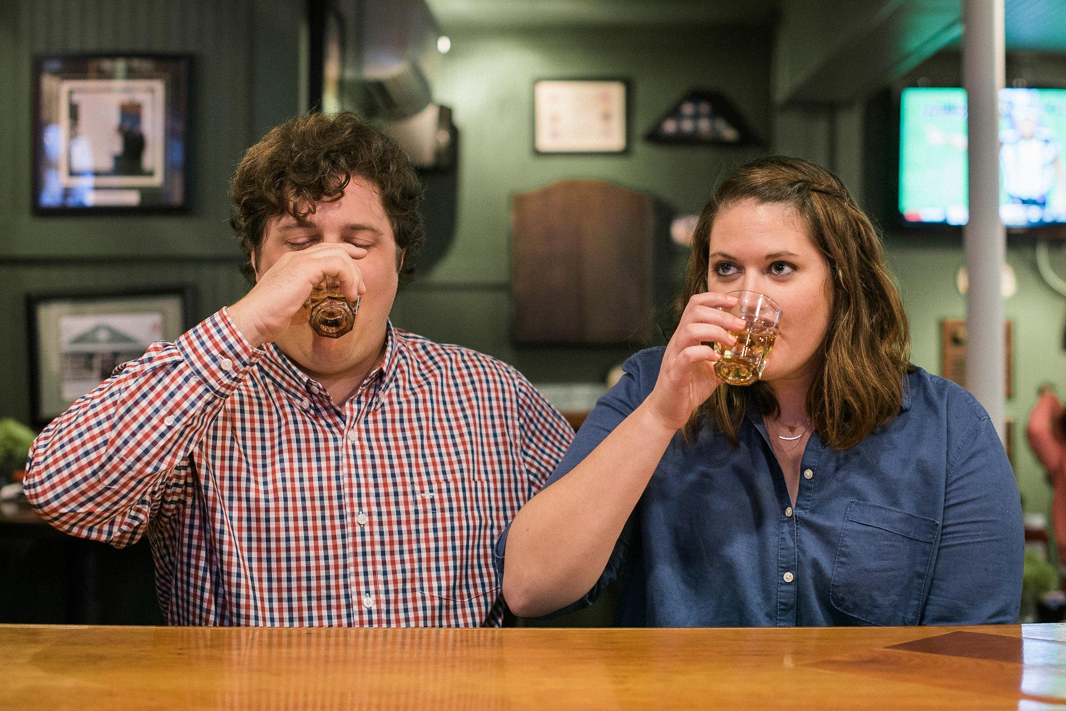 Couple drinking shot of whiskey