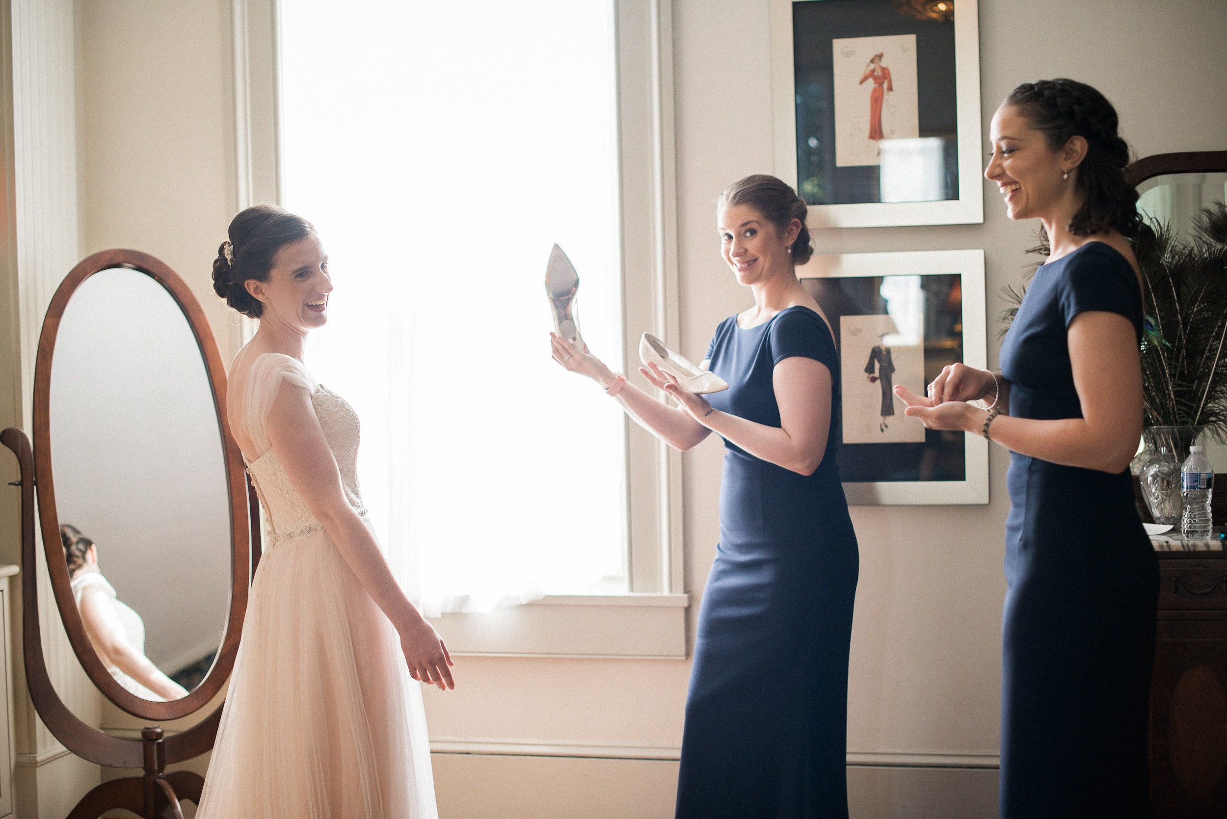 Bridesmaids giving bride shoes