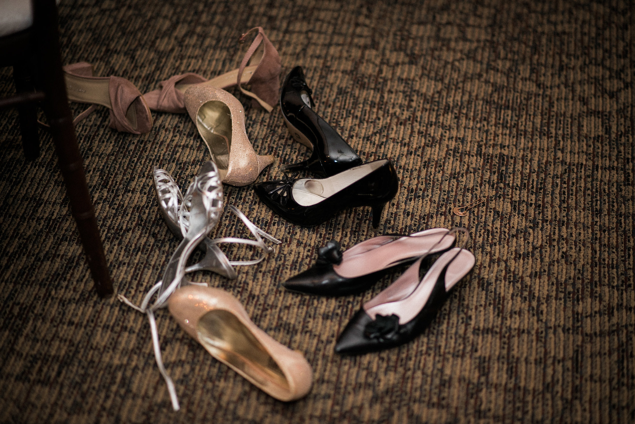 Shoes in a pile on the floor