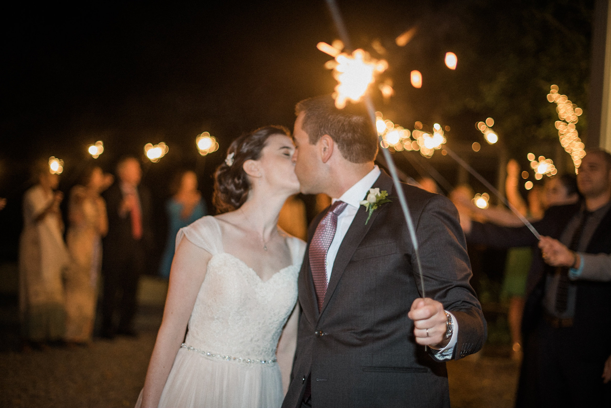 Bride adn groom with sparkler