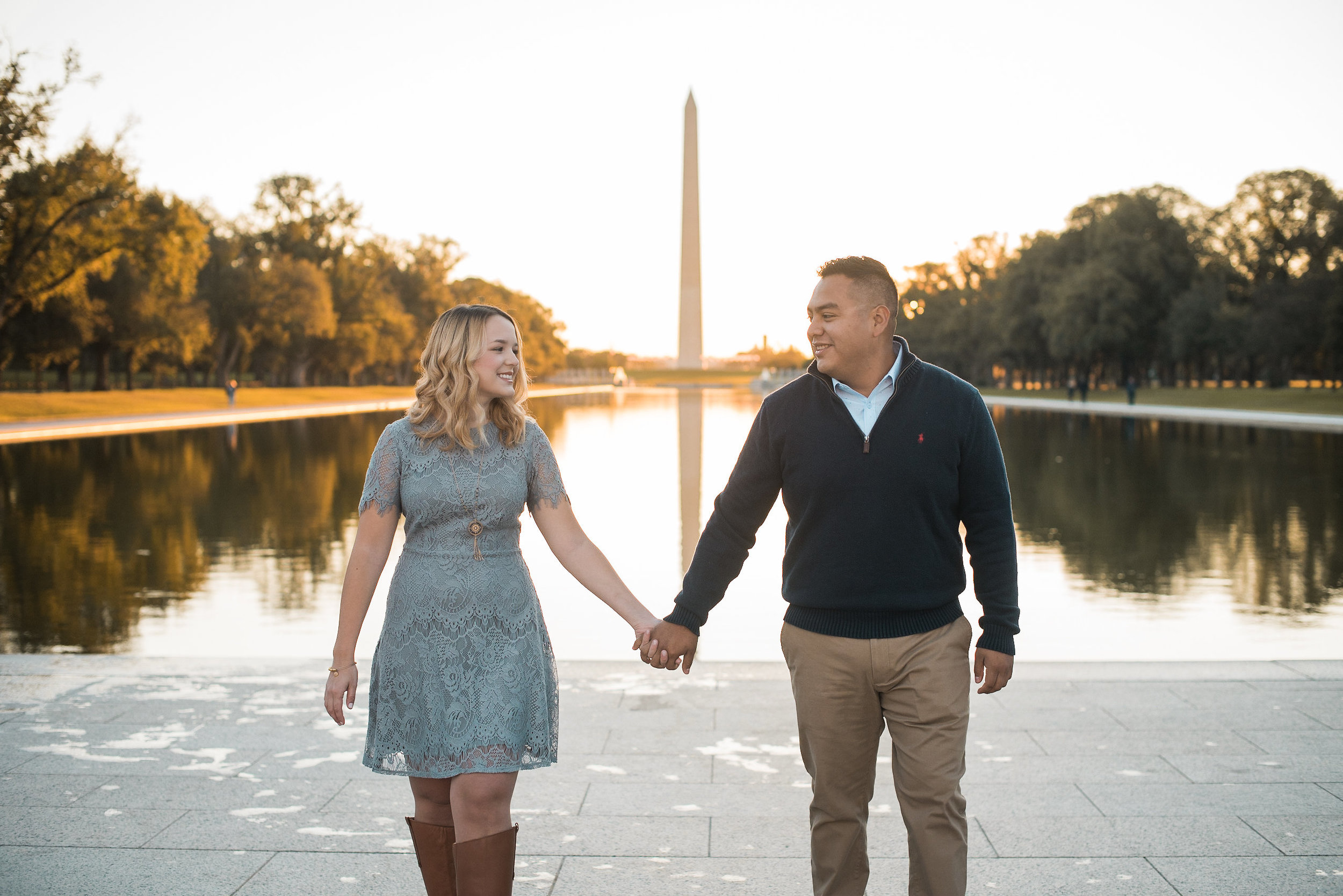 Couple holding hands in front of reflecting pool