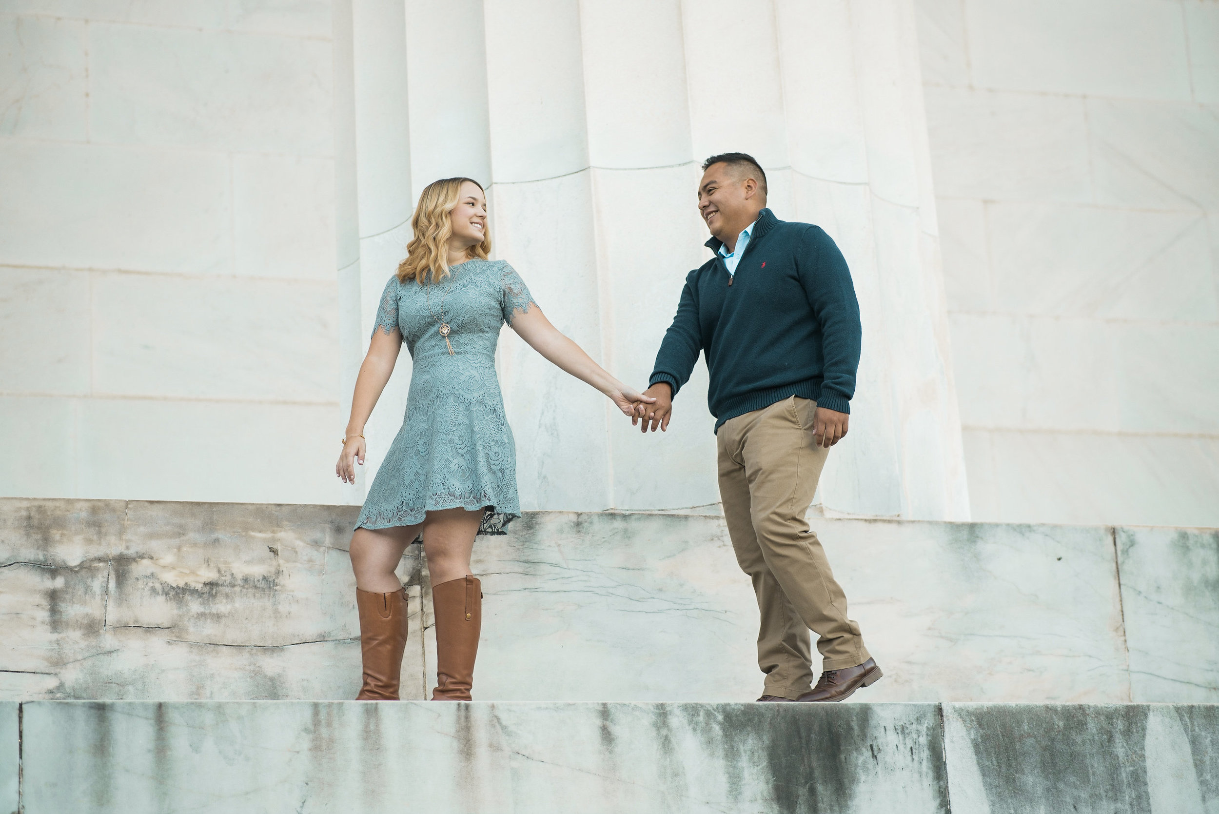 Couple walking on marble steps