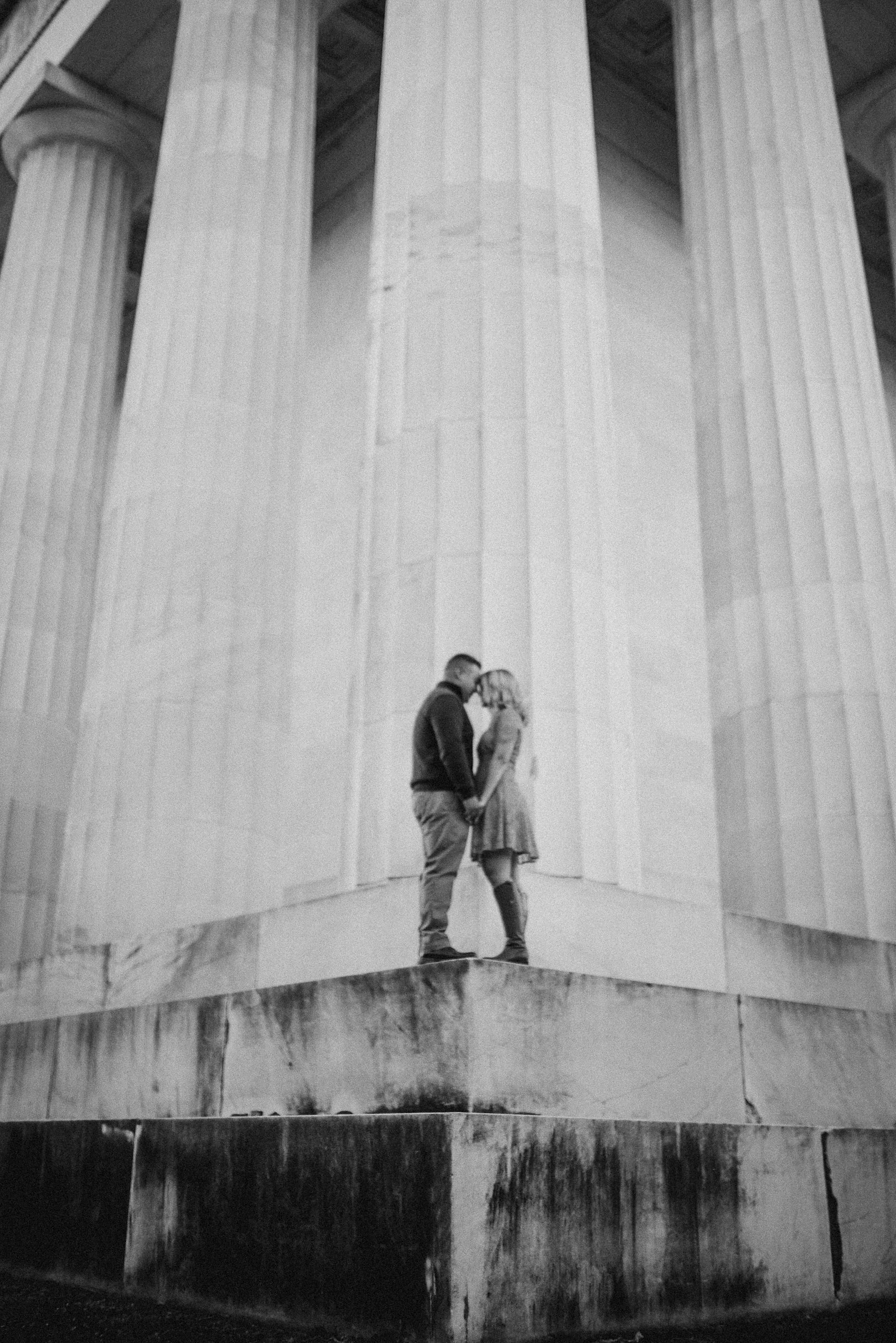 Couple standing on monument