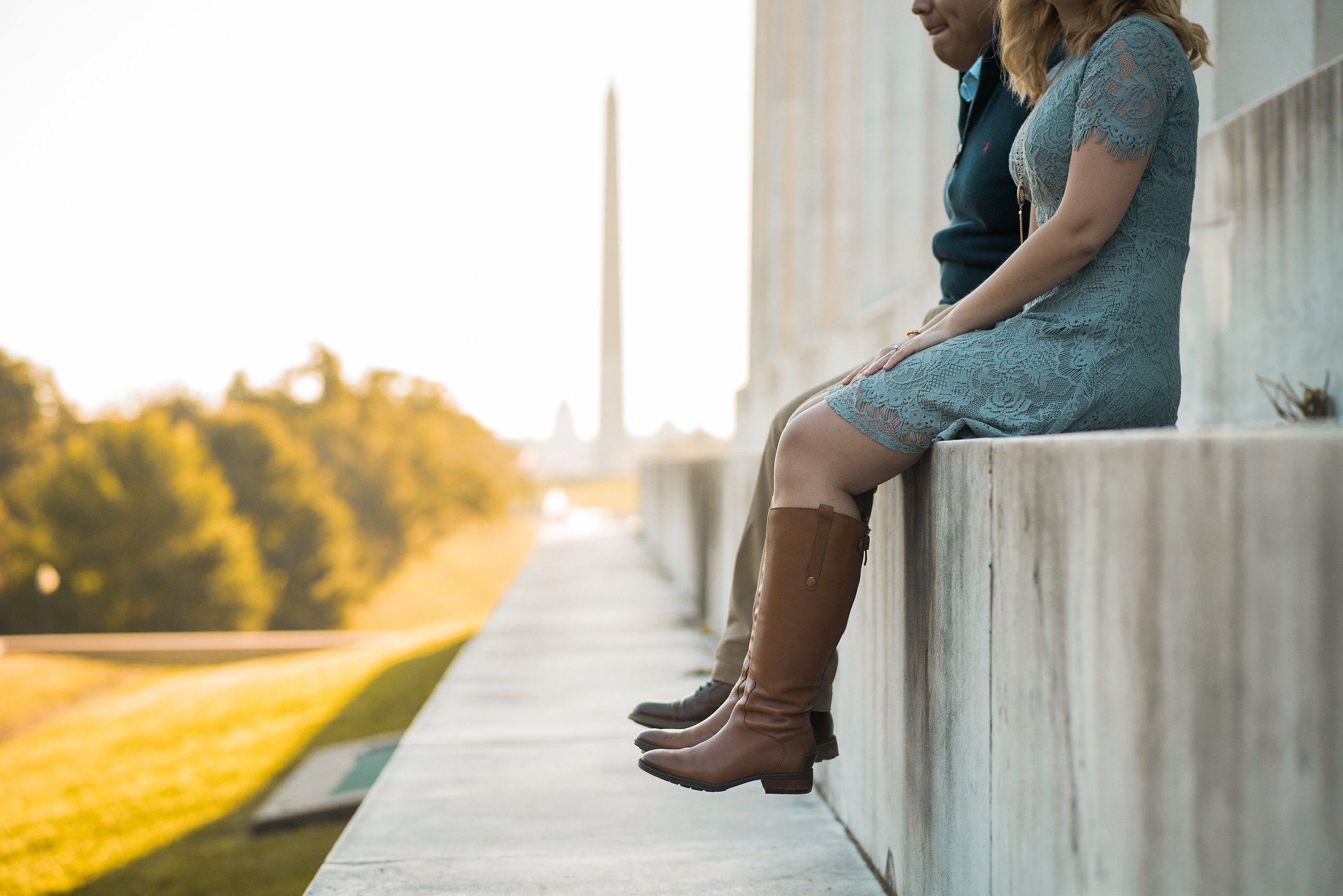 Couple sitting on step of Lincoln Memorial