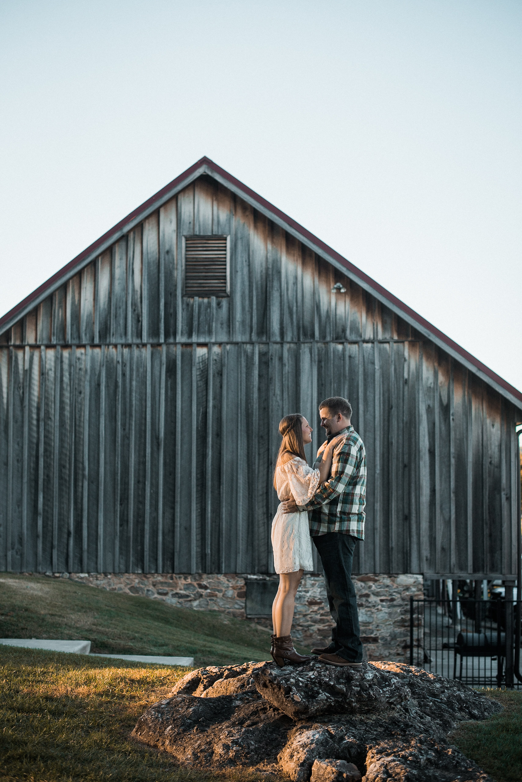 Couple standing in front of barn