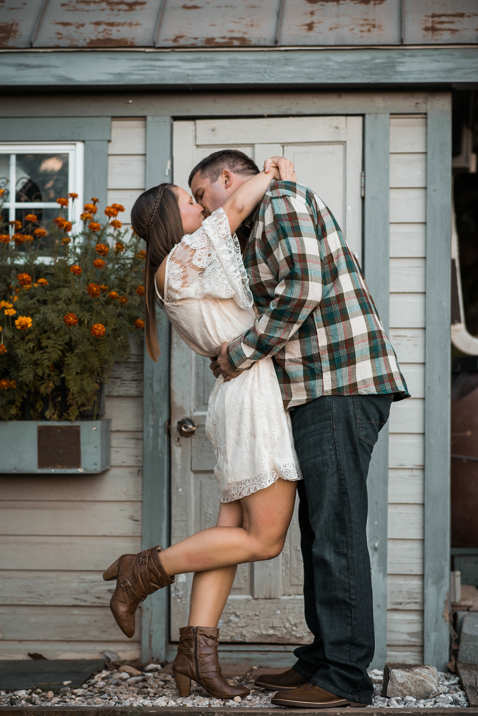 Couple kissing near cottage