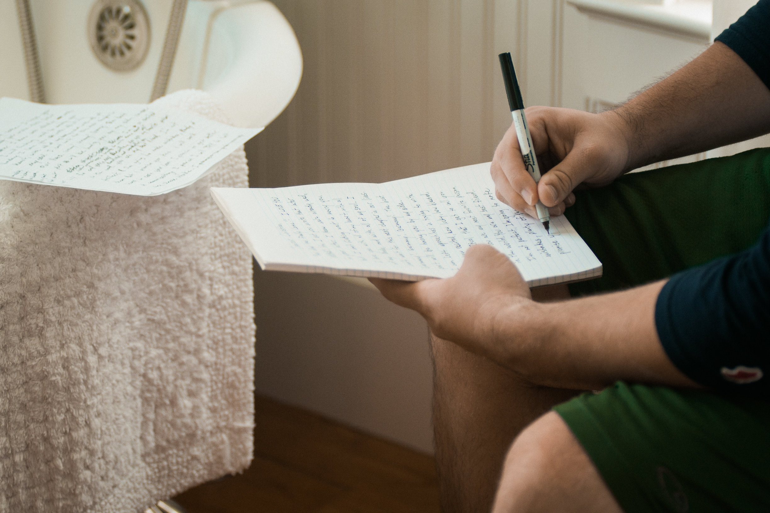 Man writing on a pad of paper