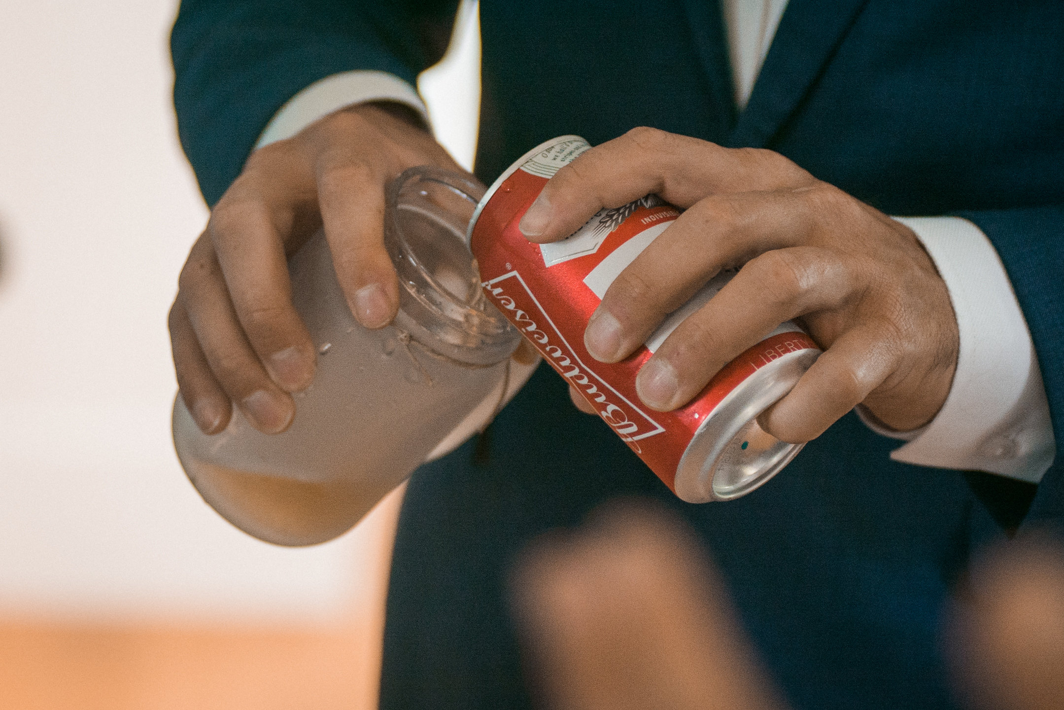 Pouring coke in mason jar