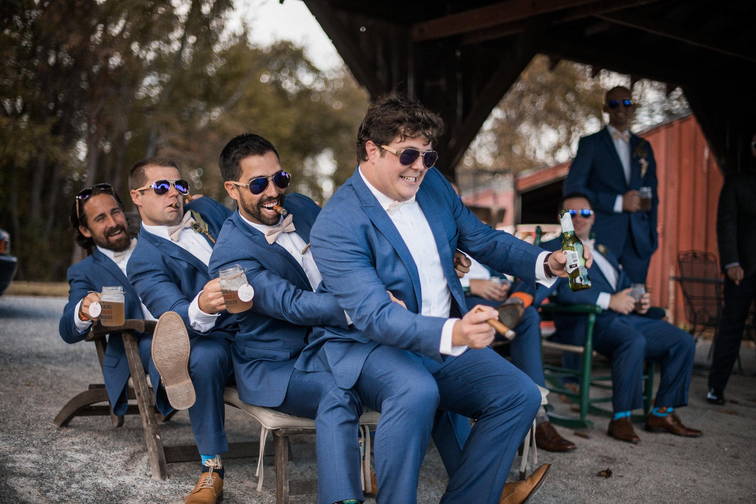Groom and groomsmen posing silly