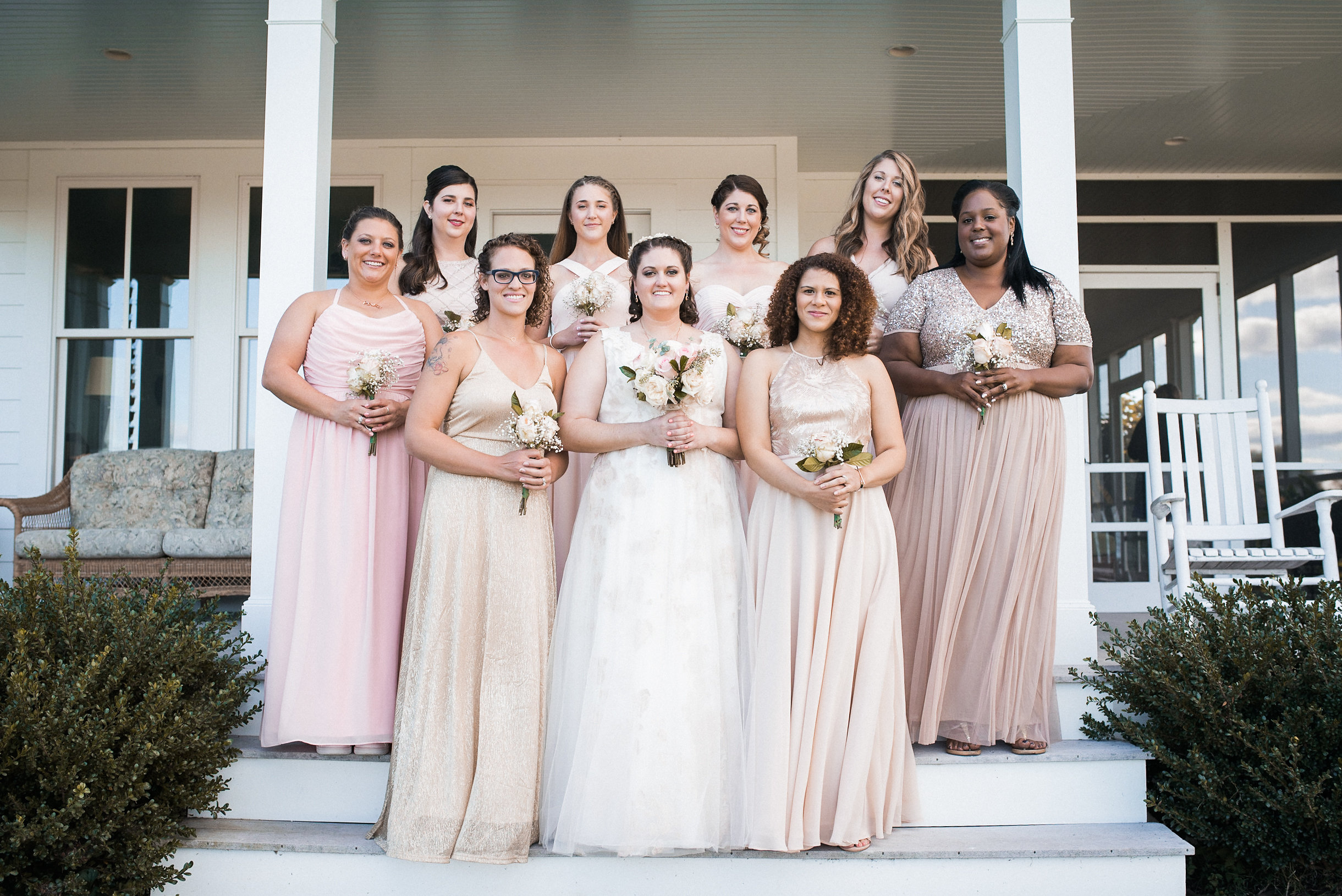 Bridal party posing on steps