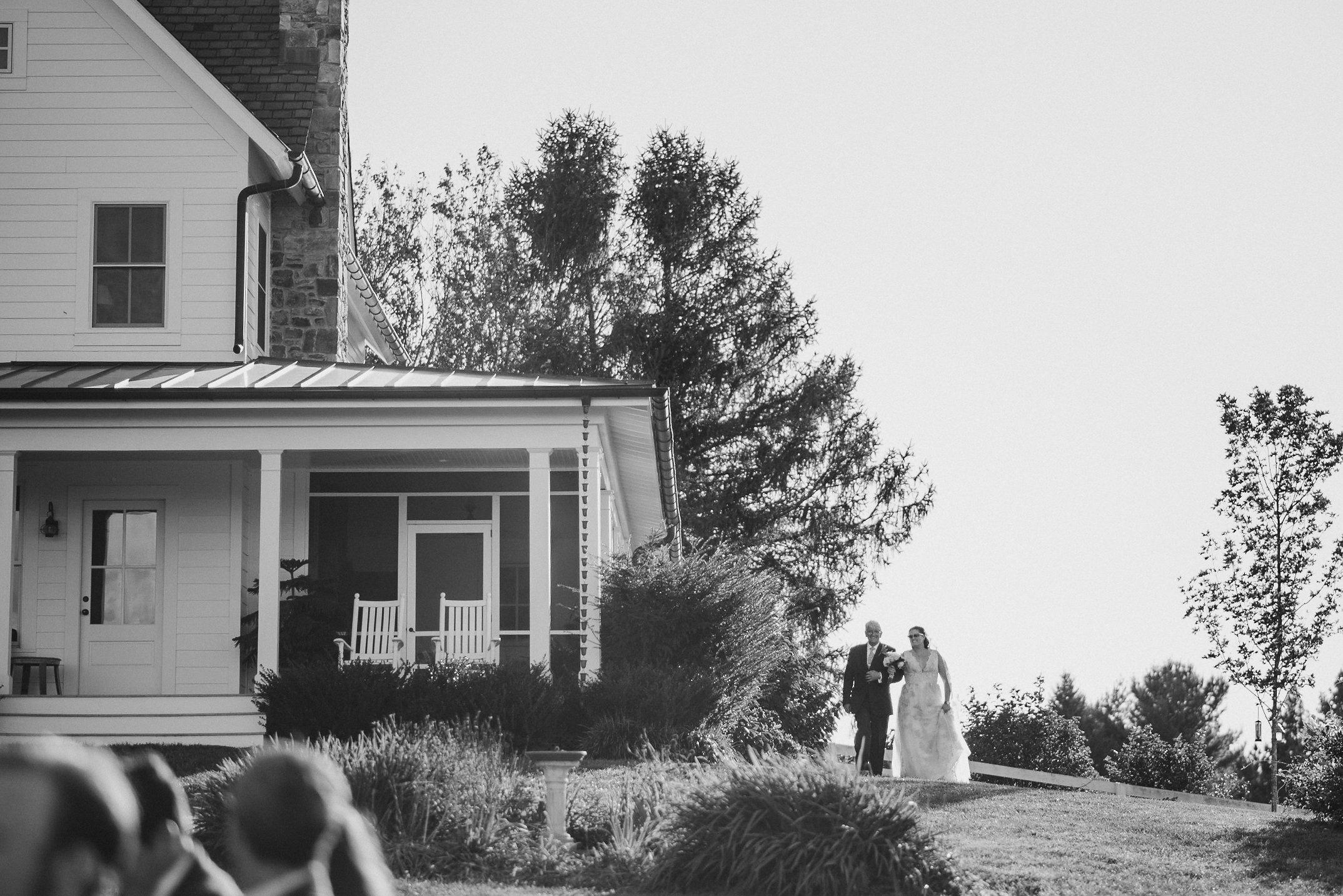 Father walking bride to wedding