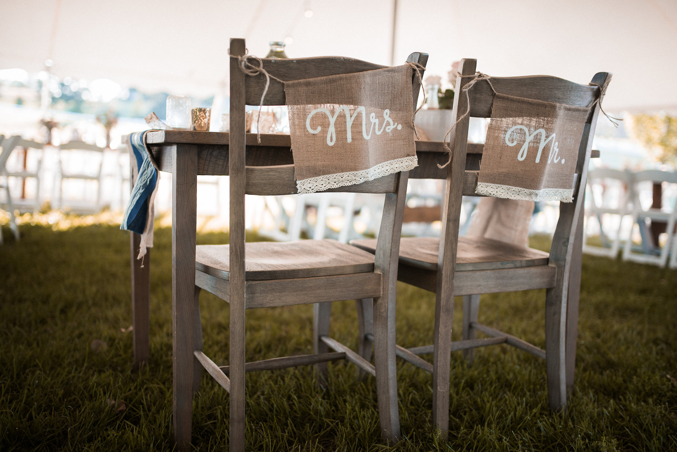 Bride and groom chairs at wedding