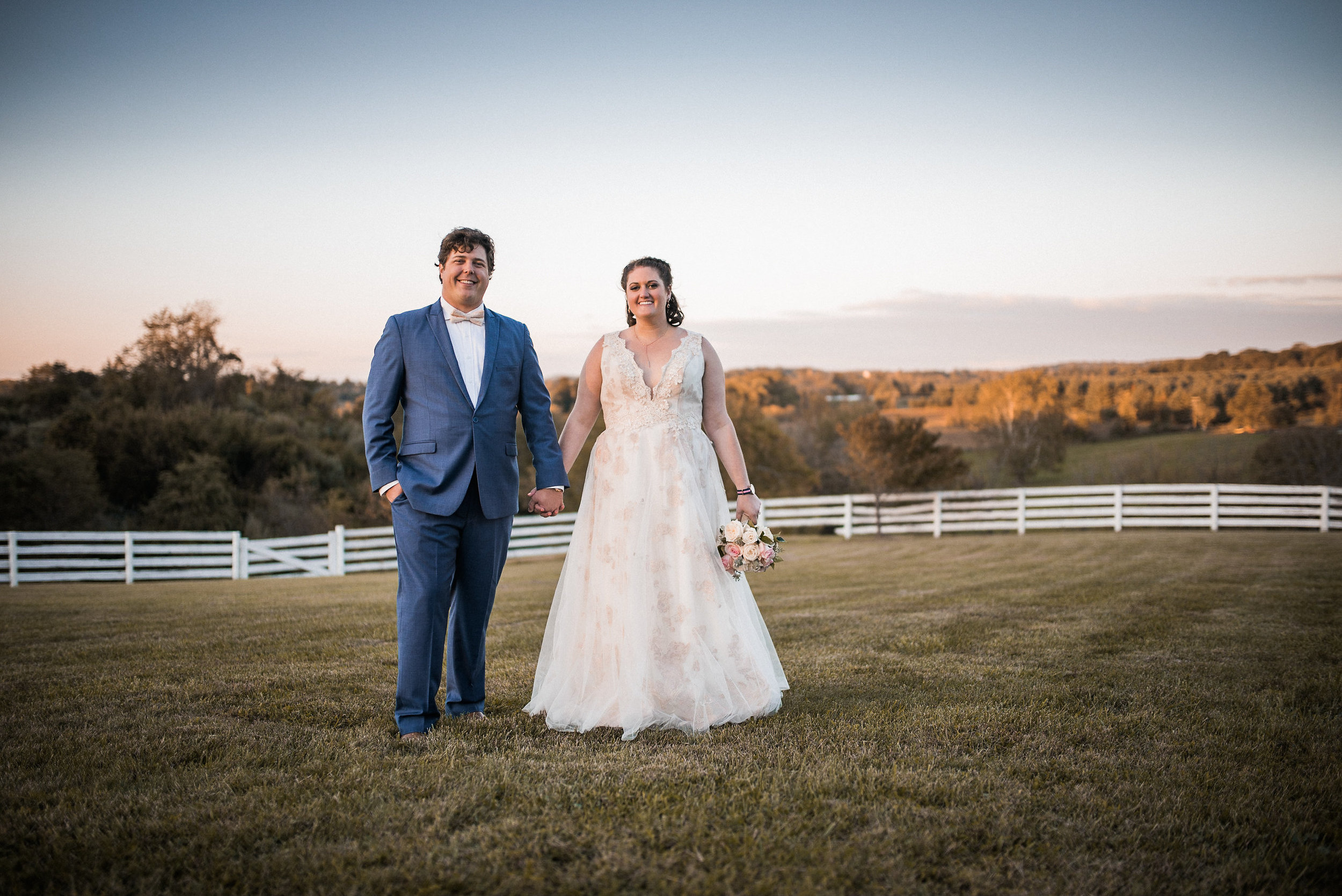 Bride and groom at sunset on farm