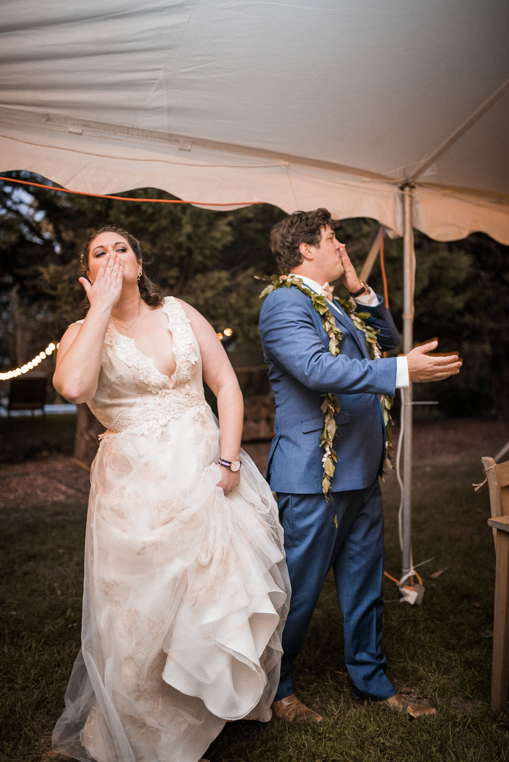 Bride and groom blowing kisses