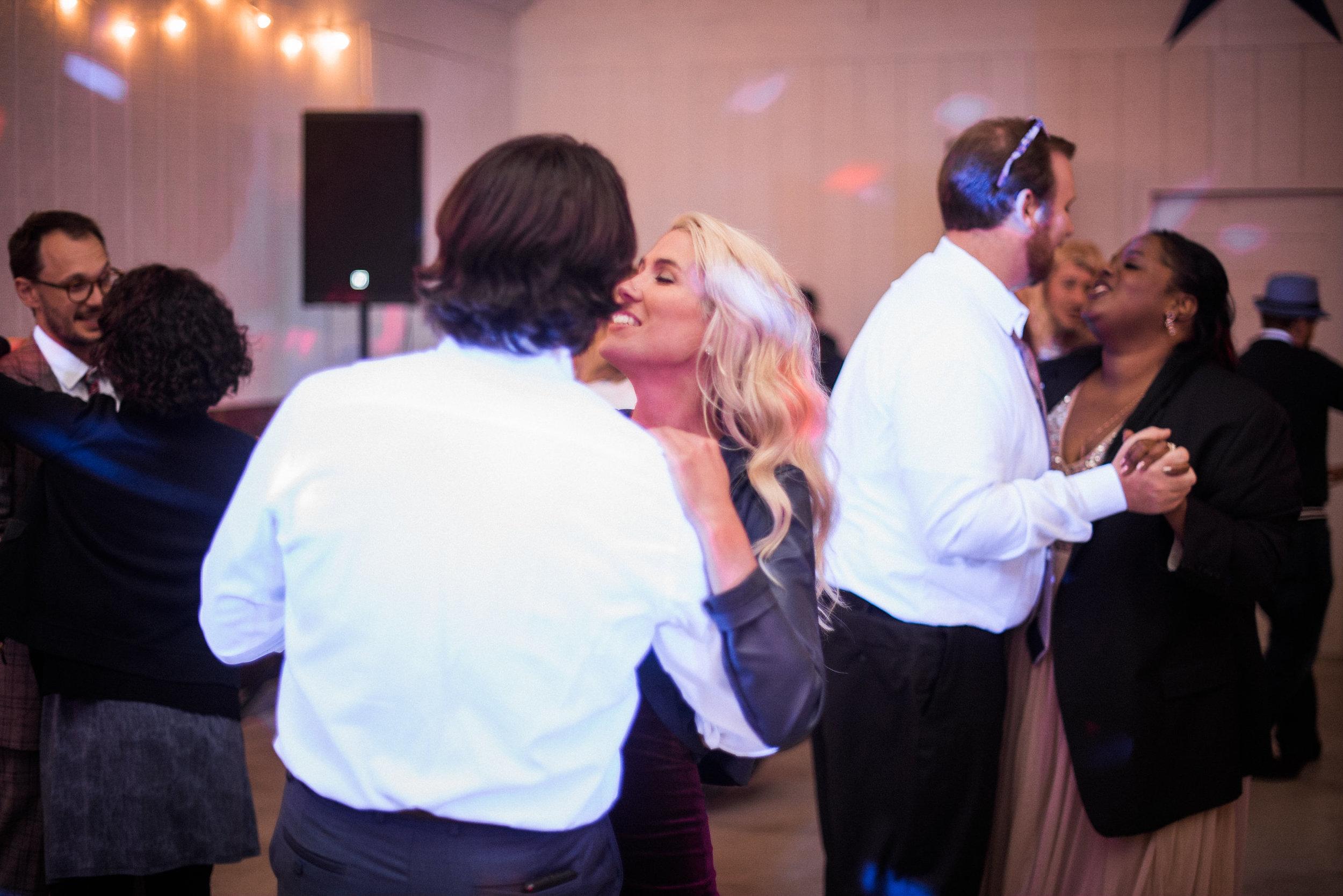 Wedding guests dancing in barn