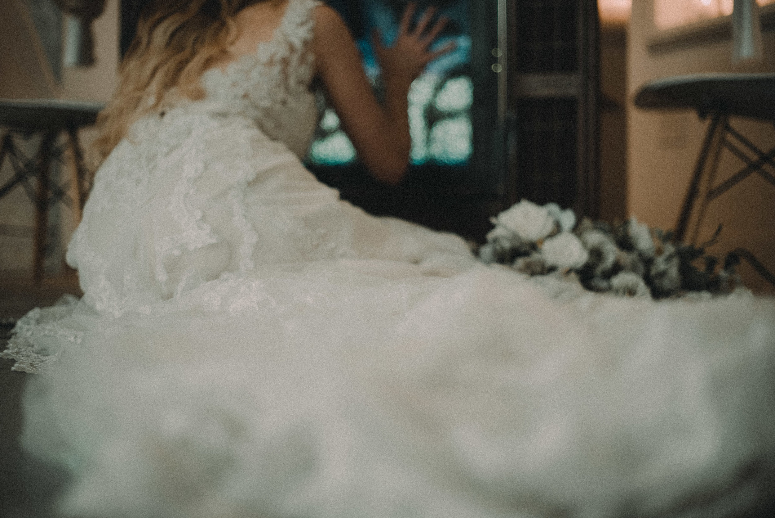 Bride lying on floor next to television