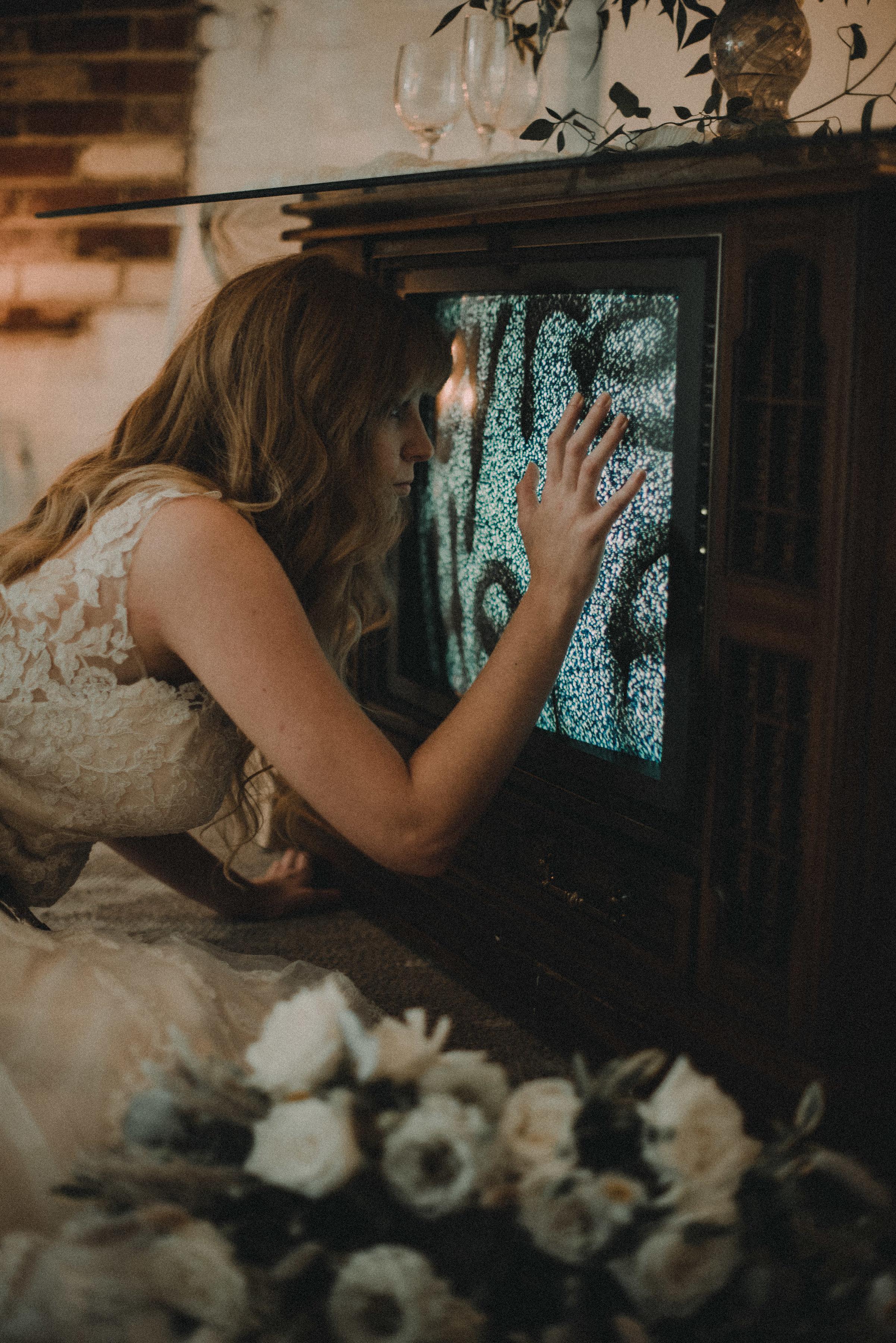 Bride looking into tv screen