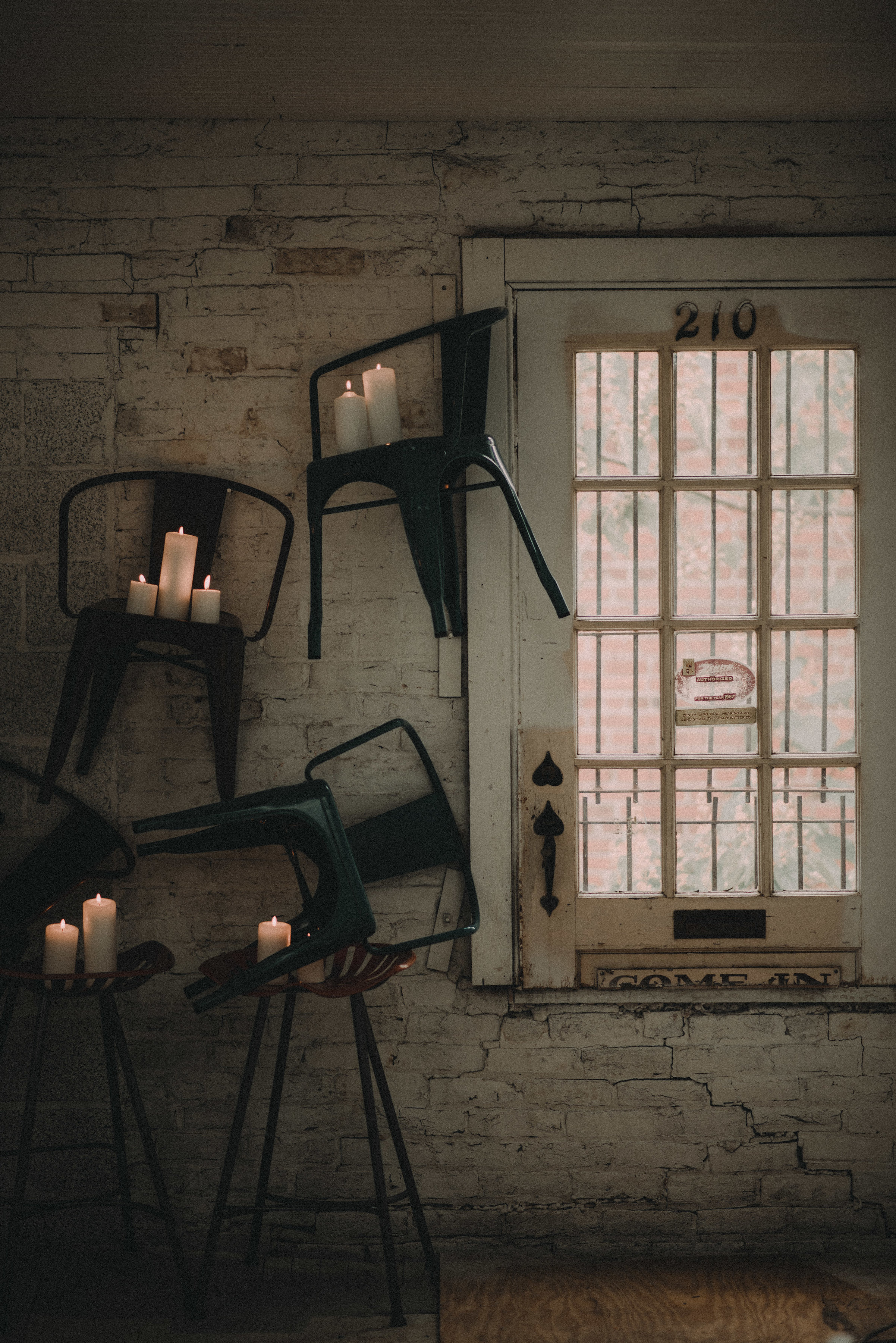Chairs and candles levitating