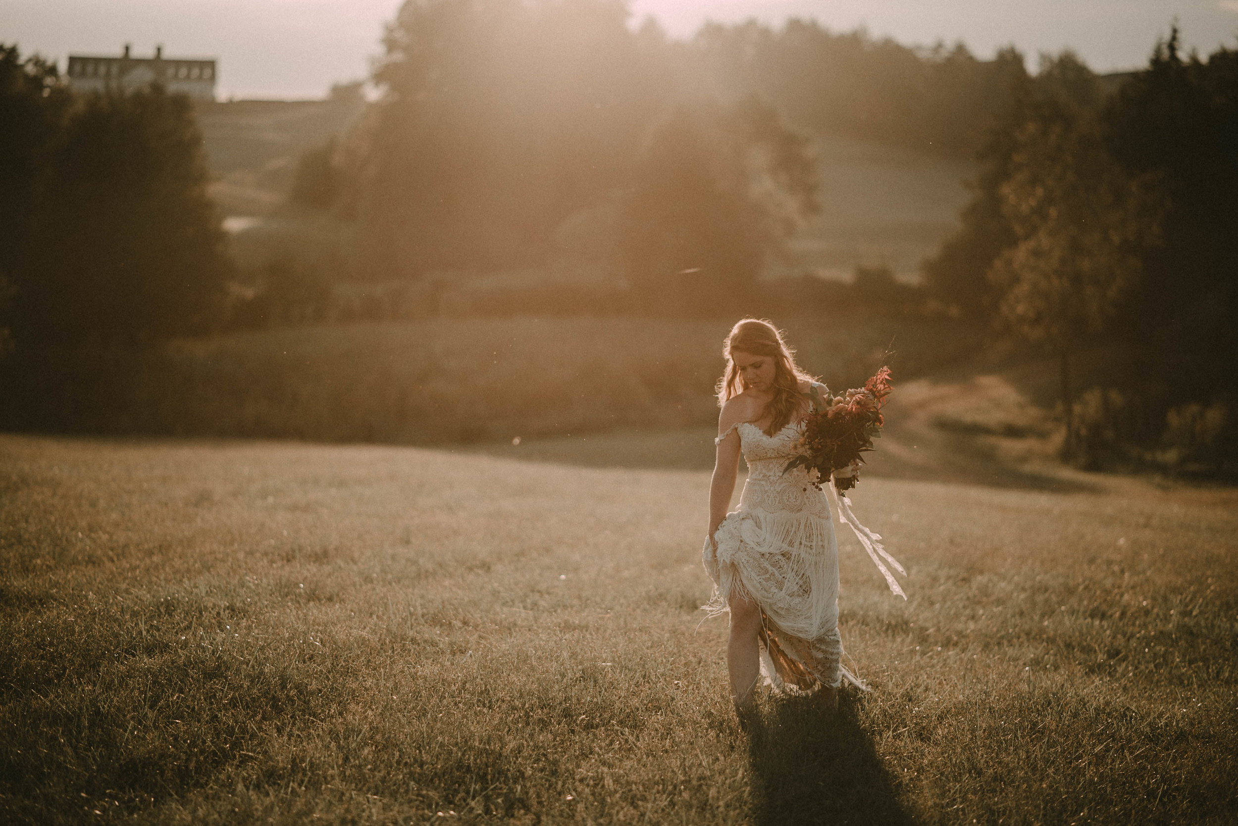 Bride walking through field