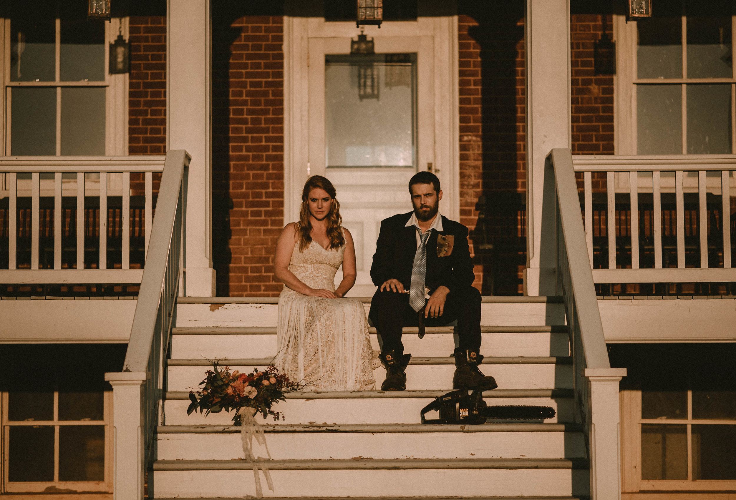Bride and groom sitting on porch