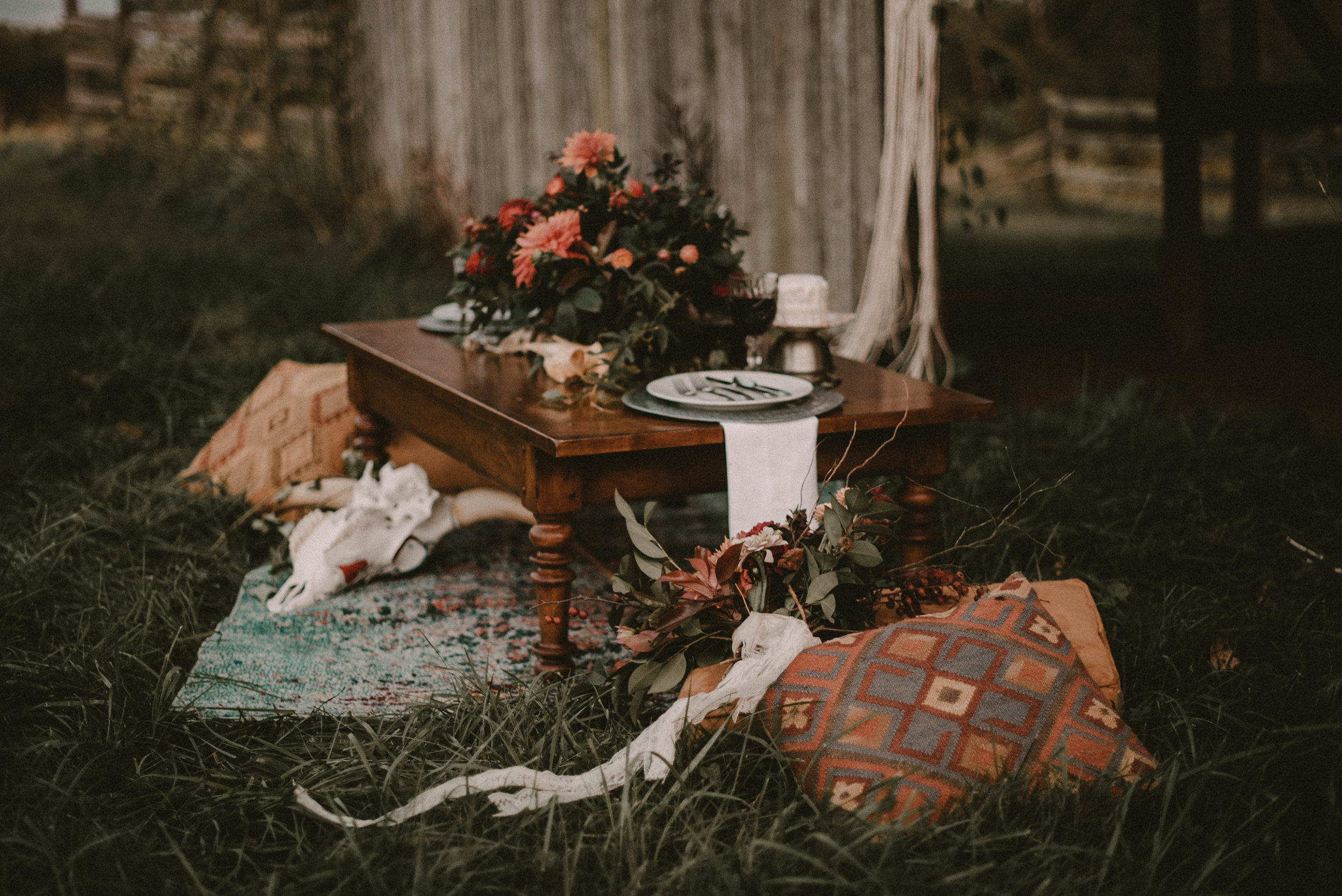 Low bride and groom table on grass