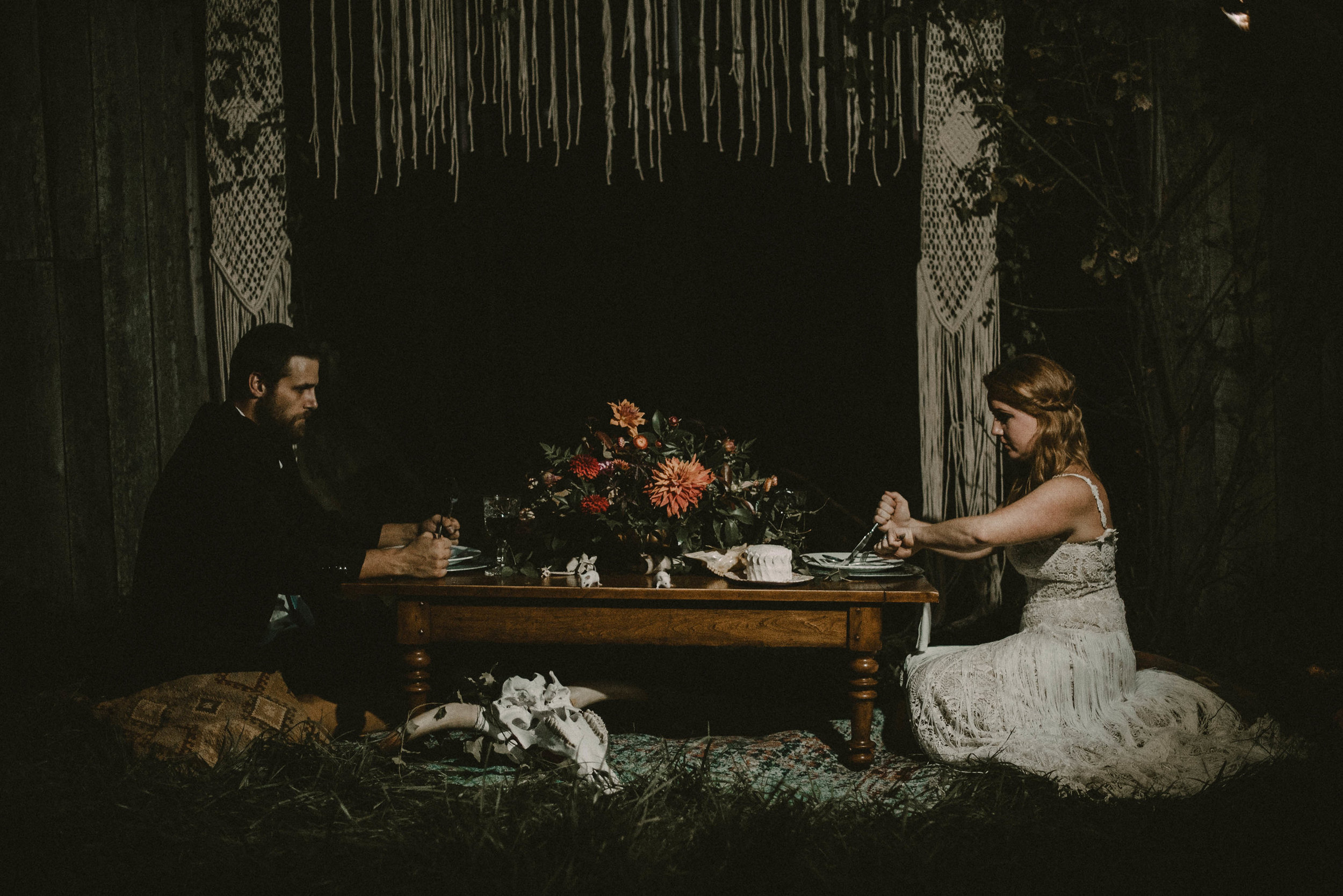 Bride and groom eating at creepy table