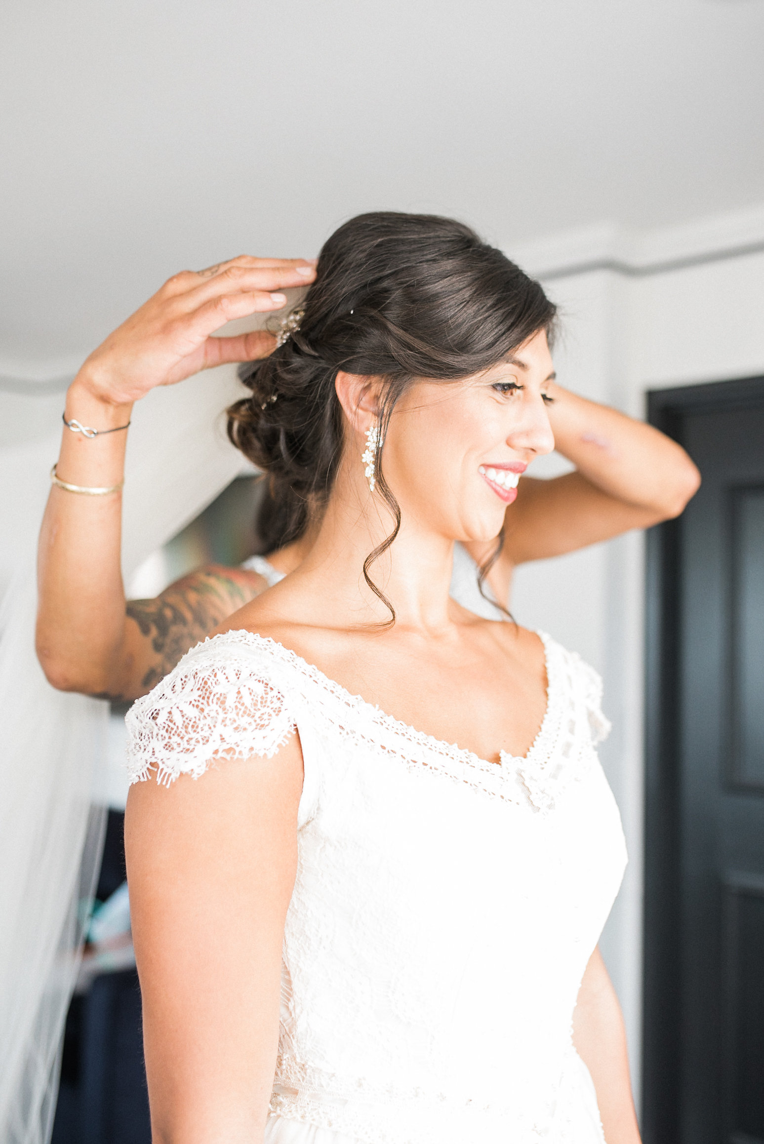 Bride getting help with hair