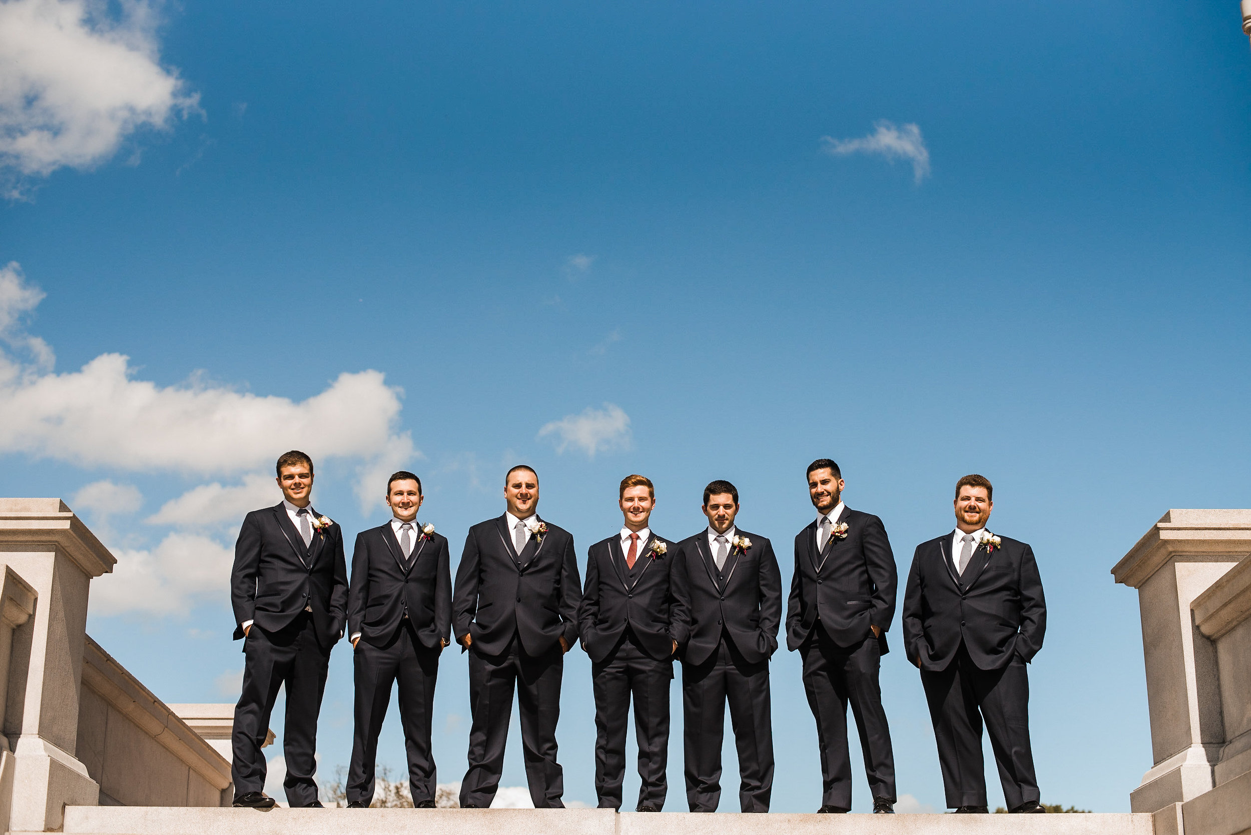 Groom and groomsmen lined up on step