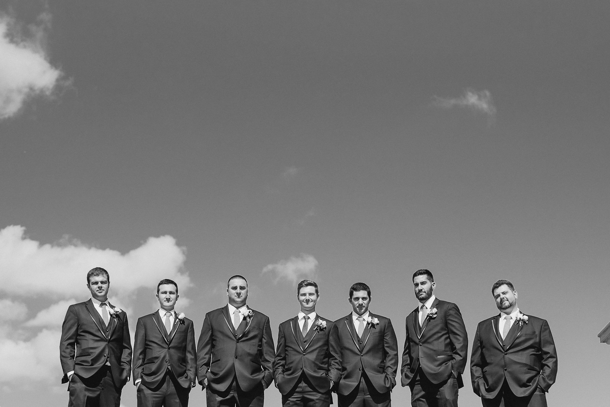 Groom and groomsmen in black and white