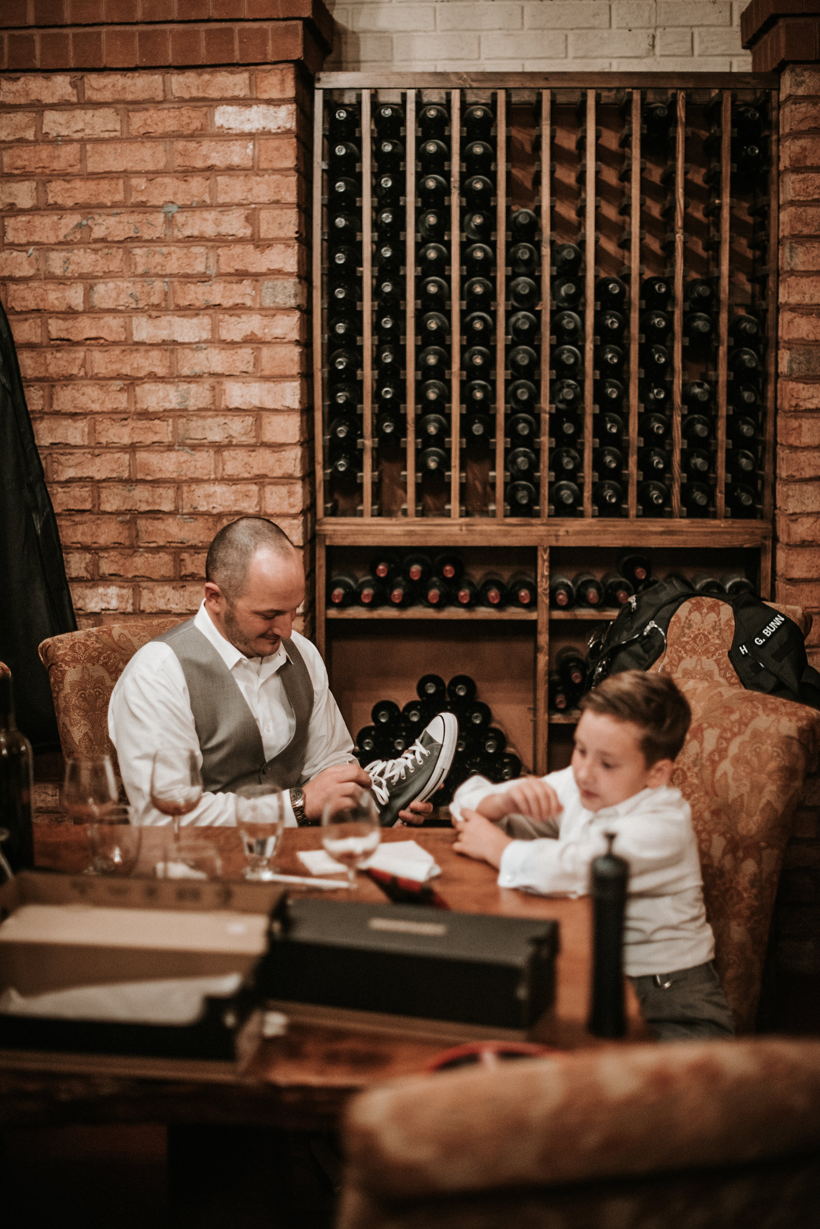 Groom sitting in wine cellar