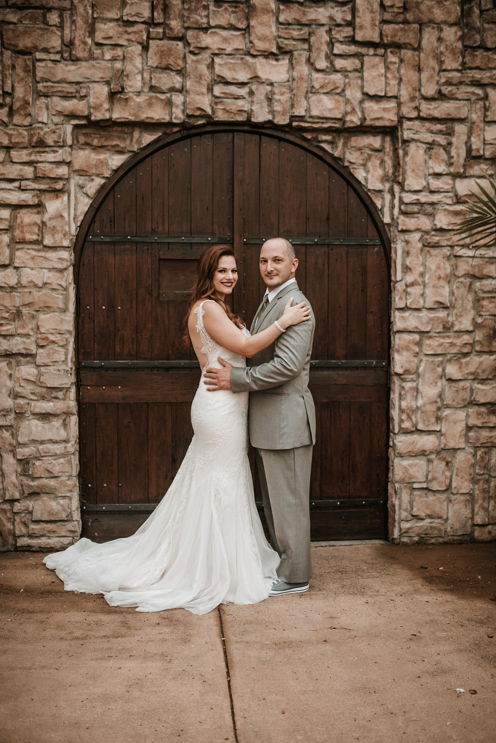 Bride and groom in front of winery door