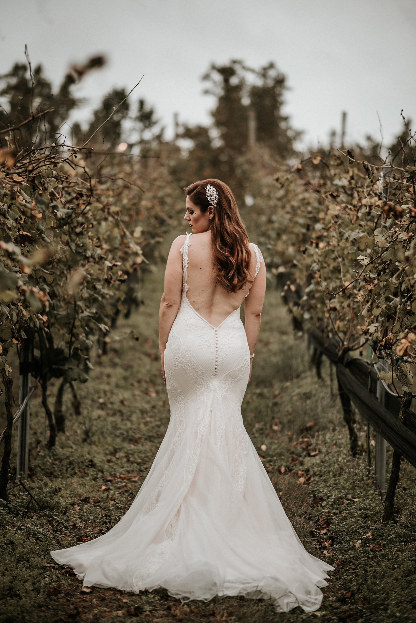 Bride posing in fall vineyard