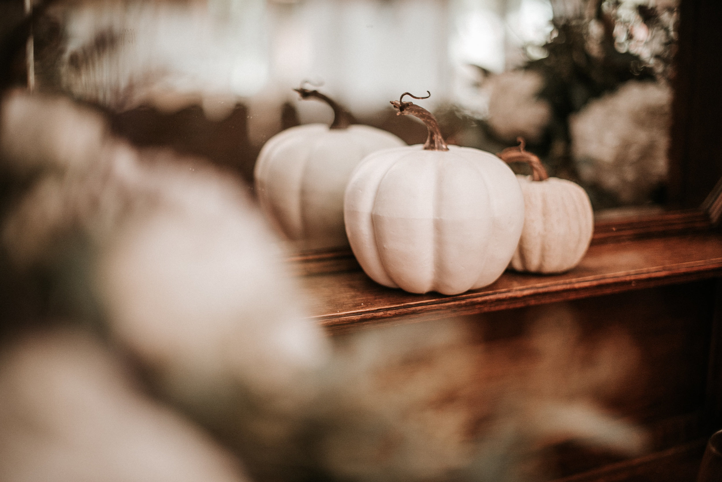 White pumpkins at wedding